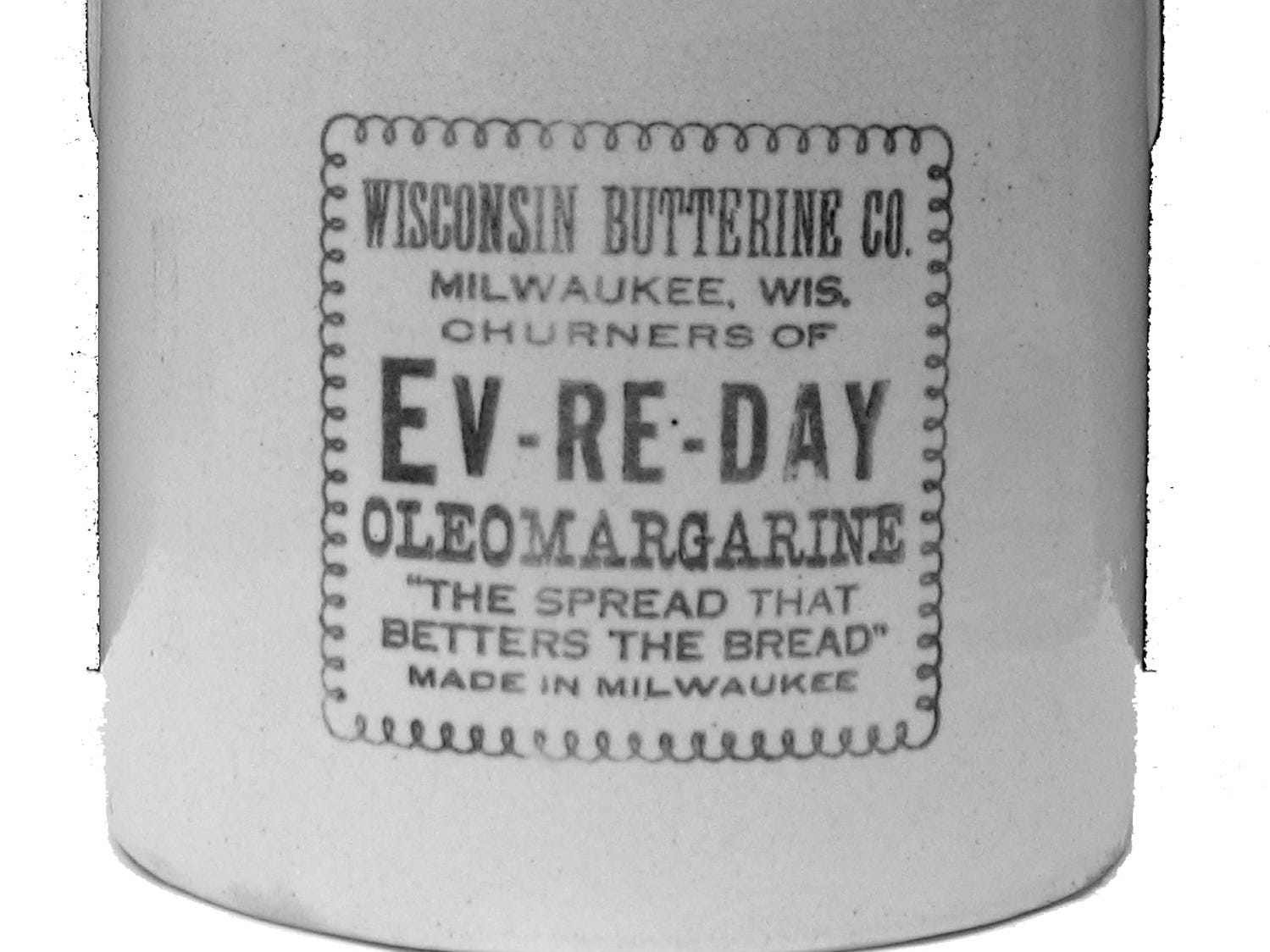 """The oleo wars have a long history in Wisconsin. This stoneware margarine crock from the early 1900s reflects the margarine-butter controversy in its slogan: """"The Spread that Betters the Bread."""""""