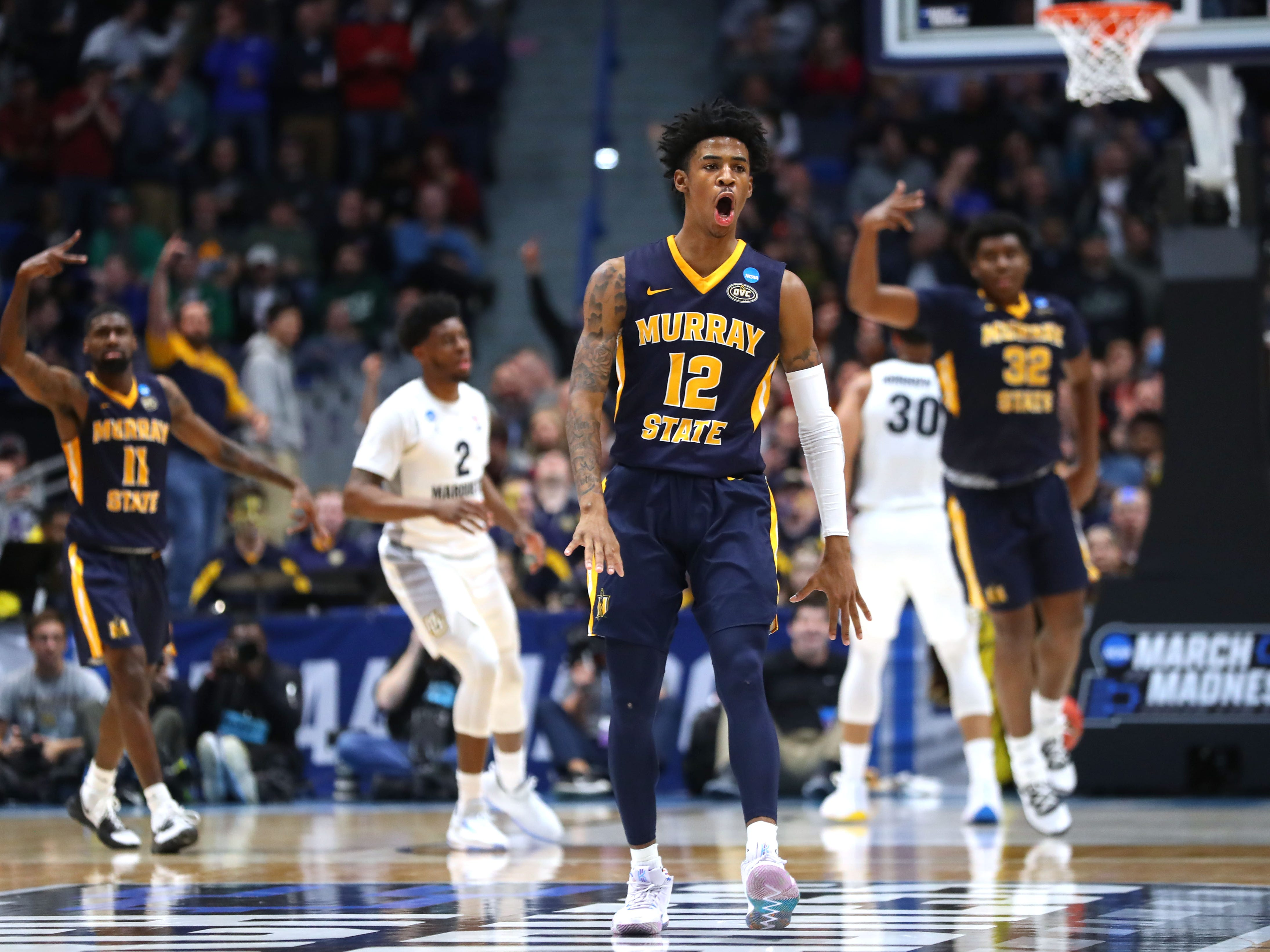 Murray State star Ja Morant whoops it up after hitting a shot against Marquette at the end of the first half.