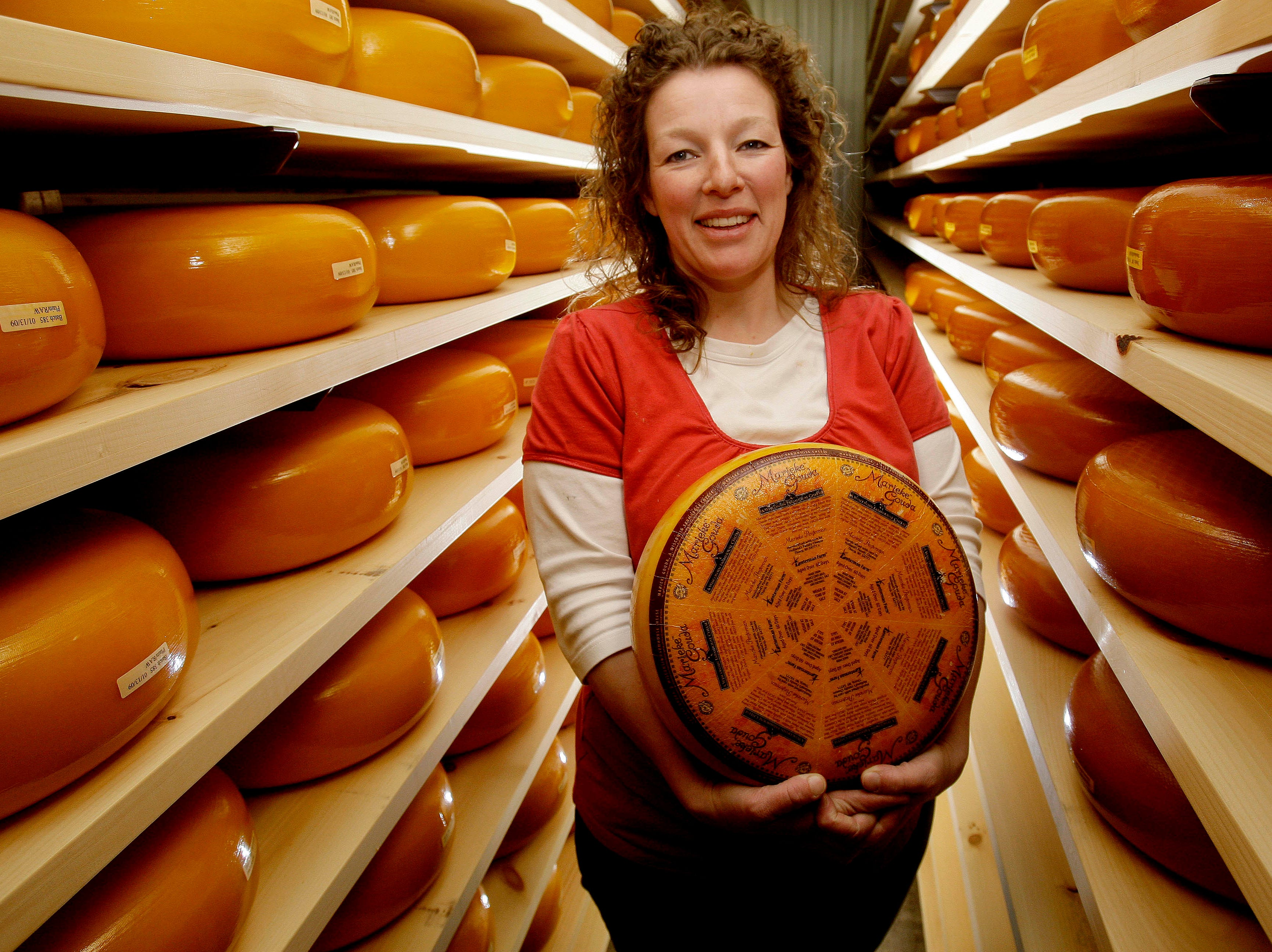 2009: Sometimes the competition dairy producers encounter is imported. Marieke Penterman is shown in the aging room at Holland's Family Farm in Thorp. Marieke and Rolf Penterman emigrated from the Netherlands in 2002 to pursue their passion for dairy farming. At the 2007 U.S. Championship Cheese Contest held in Milwaukee, Marieke won Best of Class in the Open Class for Flavored Semi-soft Cheeses with her Feonegreek Gouda.
