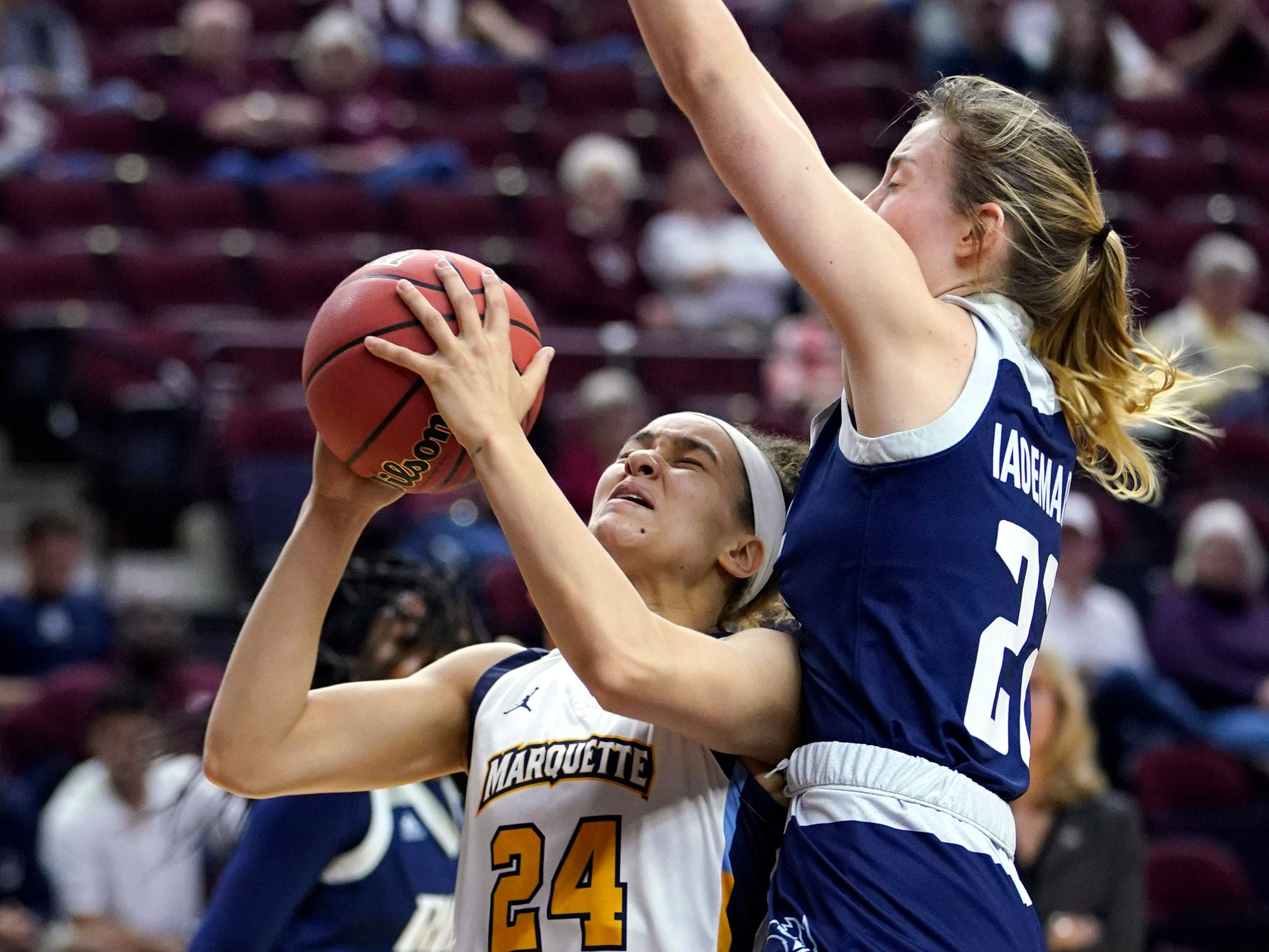 Marquette's Selena Lott tries to get a shot off against Rice's Nicole Iademarco during the first half.