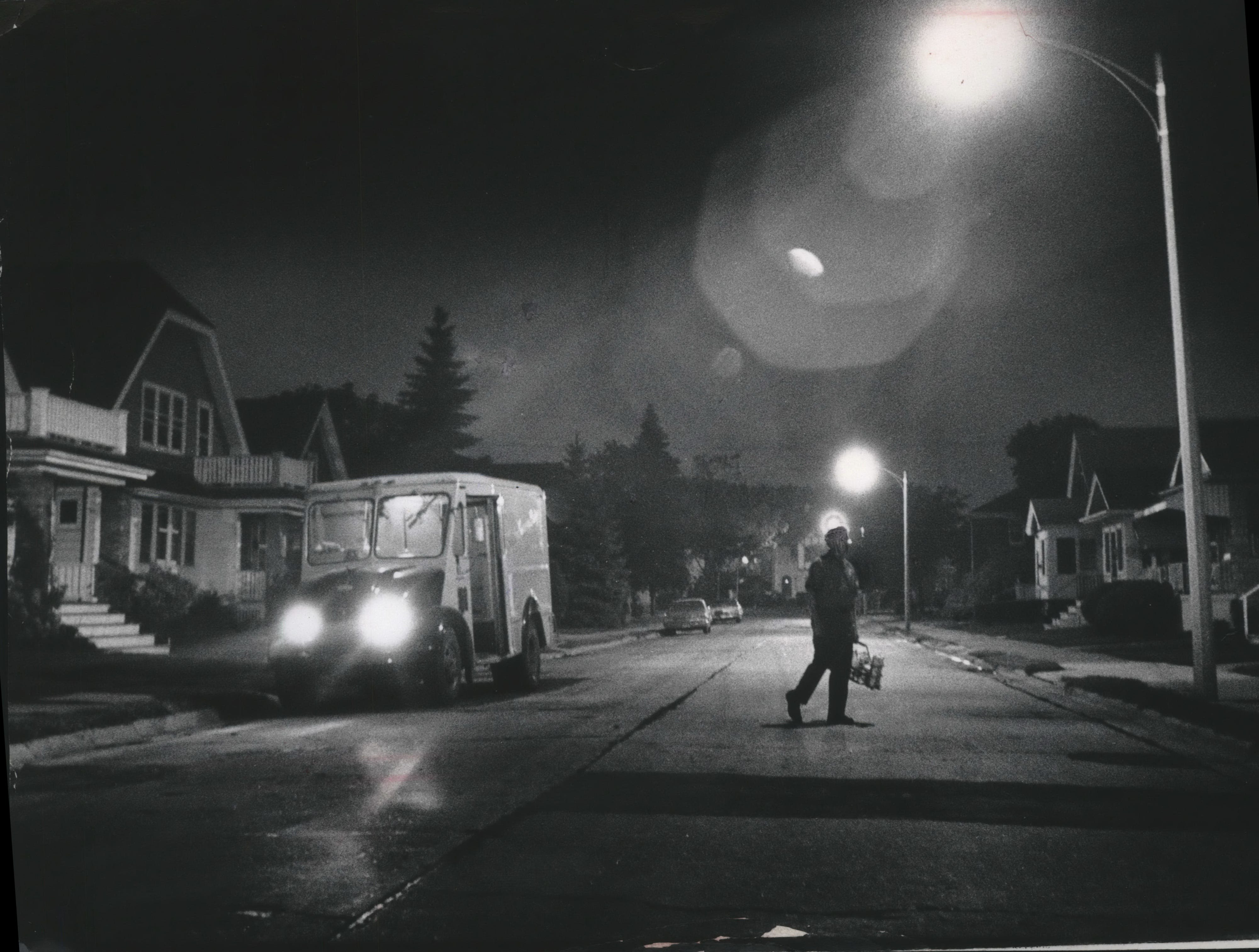 1973: Though home delivery was on the decline, milkman Jack Reed was busy delivering dairy products to customers on the Golden Guernsey route, which took him along streets and alleys on Milwaukee's northwest side.