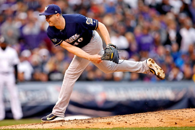 Corey Knebel will get opinions from specialists on the elbow discomfort he is experiencing in his pitching arm before the Brewers right-hander decides on a course of action.