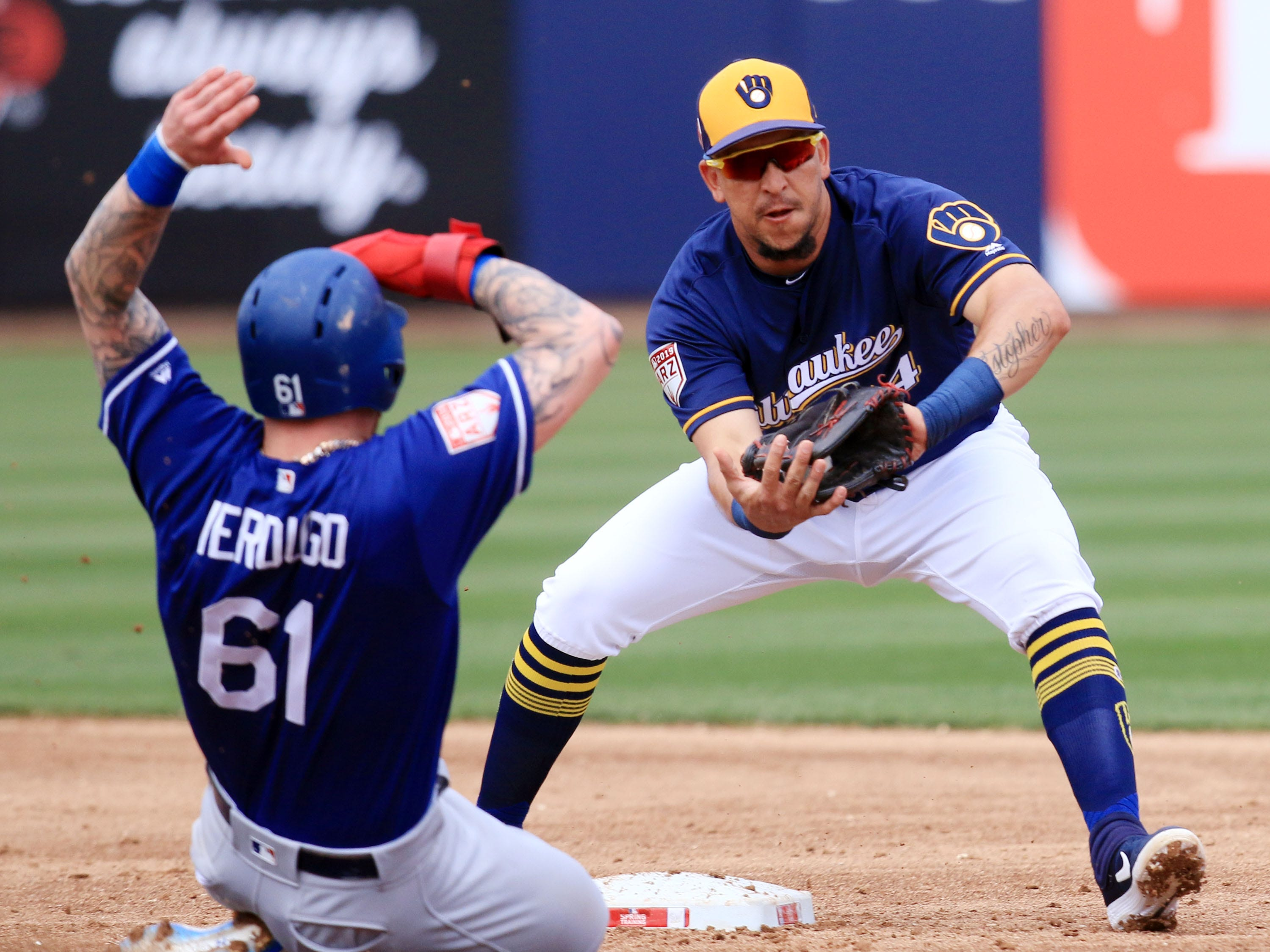 Brewers shortstop Hernan Perez receives a throw from Mike Moustakas to force out Alex Verdugo of the Dodgers at second during the second inning.