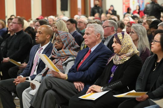 Lt. Gov. Mandela Barnes, from left, U.S. Rep. Gwen Moore, Milwaukee Mayor Tom Barrett and Janan Najeeb, president of the Milwaukee Muslim Women's Coalition, listen to the program at a vigil for victims of the New Zealand mosque attacks at the Islamic Society of Milwaukee in March.