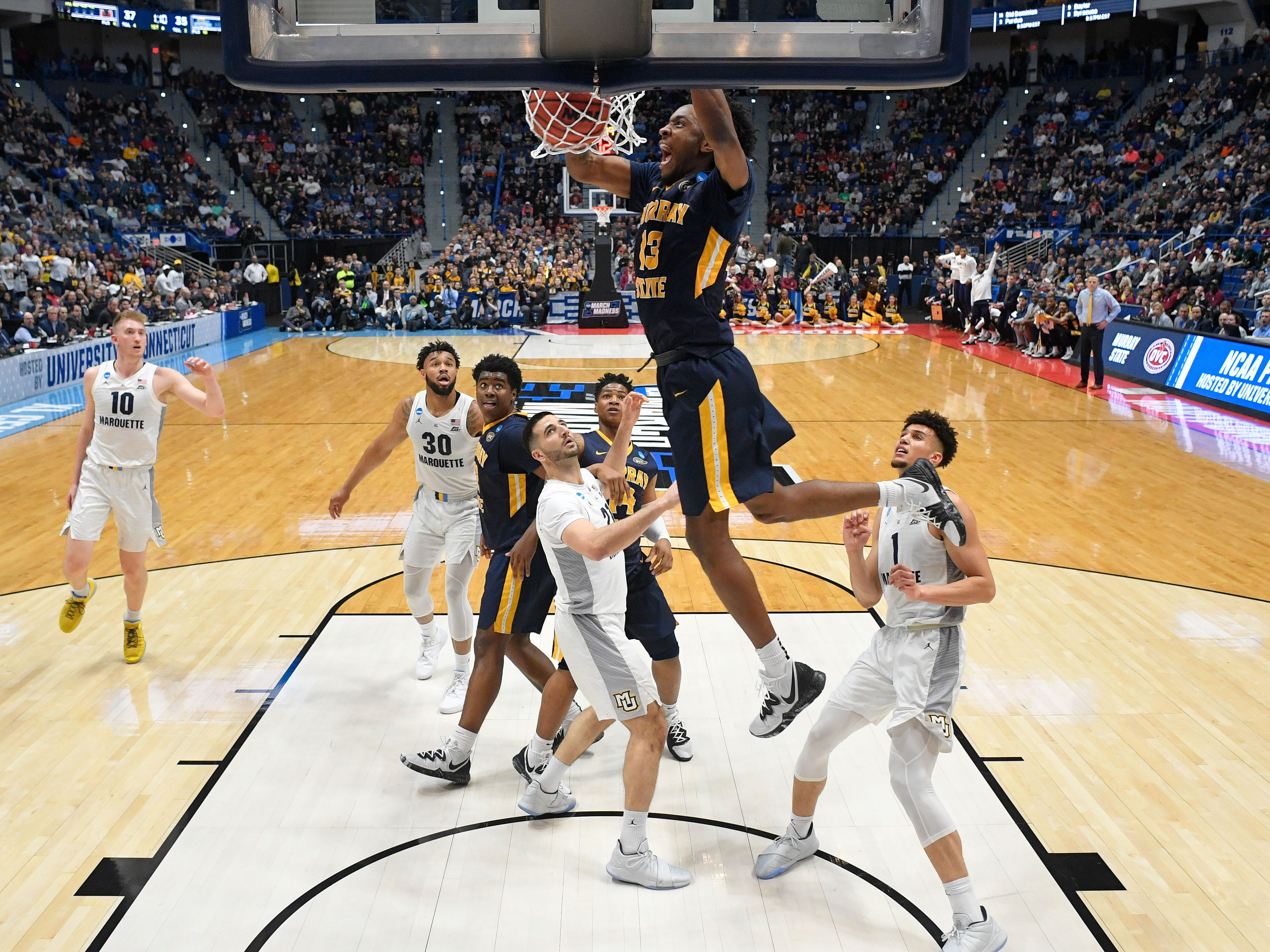Murray State forward Devin Gilmore throws home a dunk against the Golden Eagles during the first half in the first round.