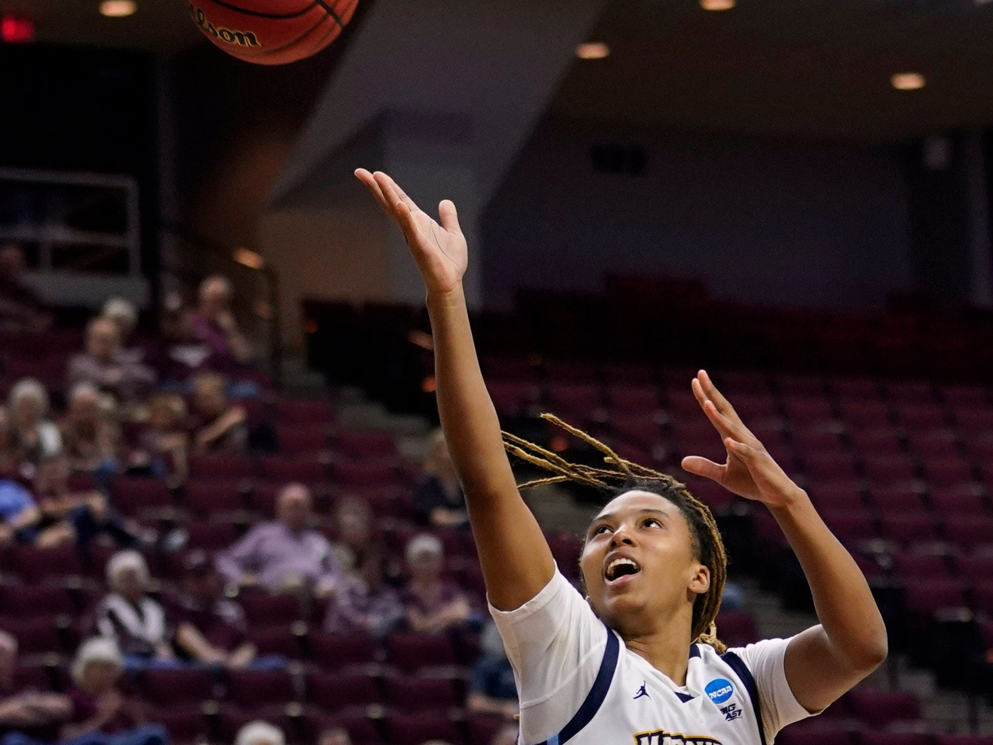 Marquette's Amani Wilborn goes up for a shot as Rice's Erica Ogwumike looks on during the first half.