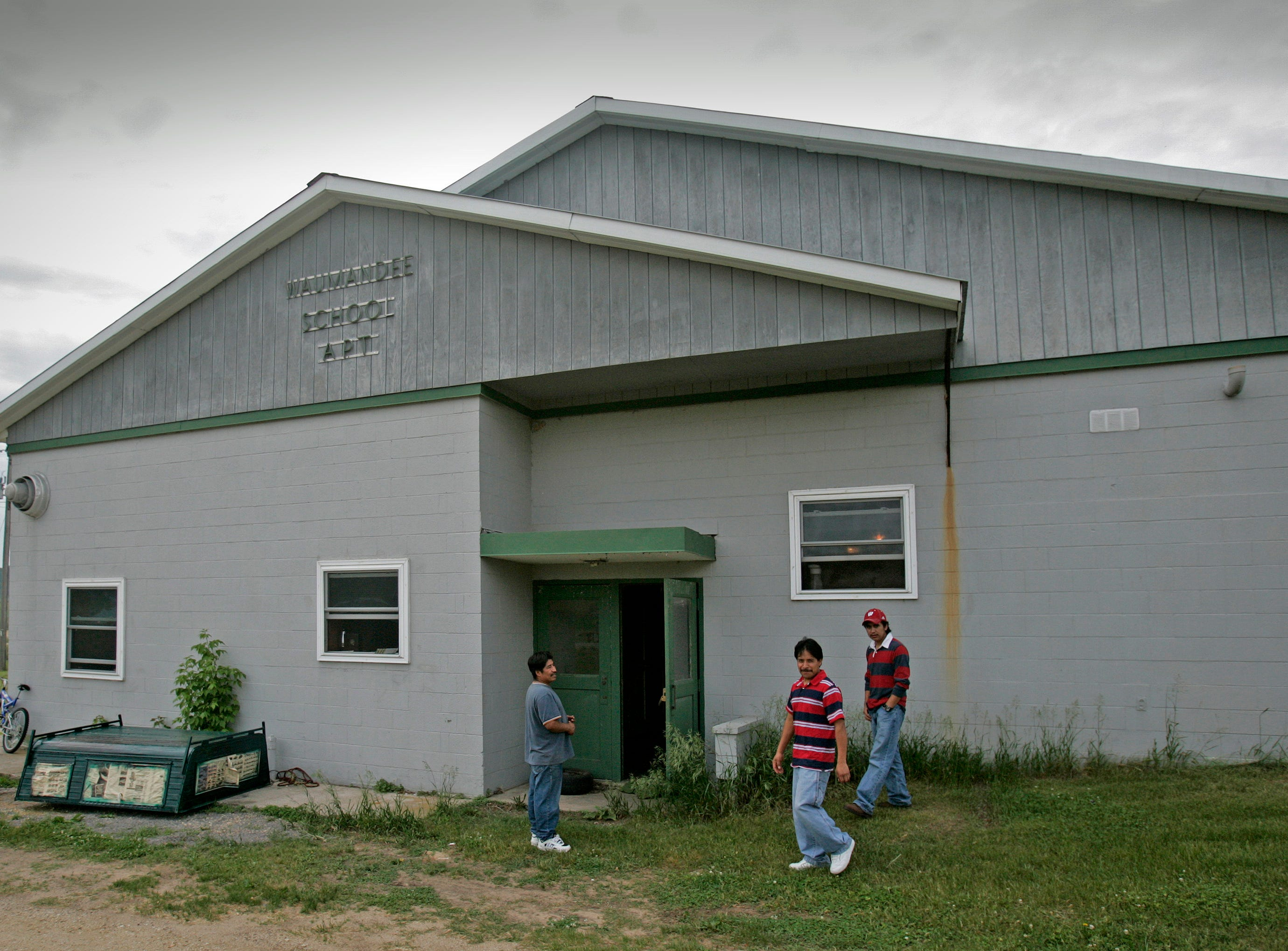 2006: Wisconsin farmers are using more imported help. Severo Sanchez, Santiago Tentzohua and Eusebio Hernandez are three of the eight workers from Mexico  working on John Rosenow's 1,000-Holstein-cow farm. An old school building was converted into apartments  to house the workers.