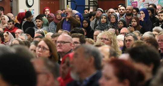 A vigil for the New Zealand terrorist attack victims was held at the Islamic Society of Milwaukee's Community Center. The large crowd filled an auditorium and was attended by members of the faith community, political figures, law enforcement officials and community members. Here people fill the room to listen to the program and show support for the victims.