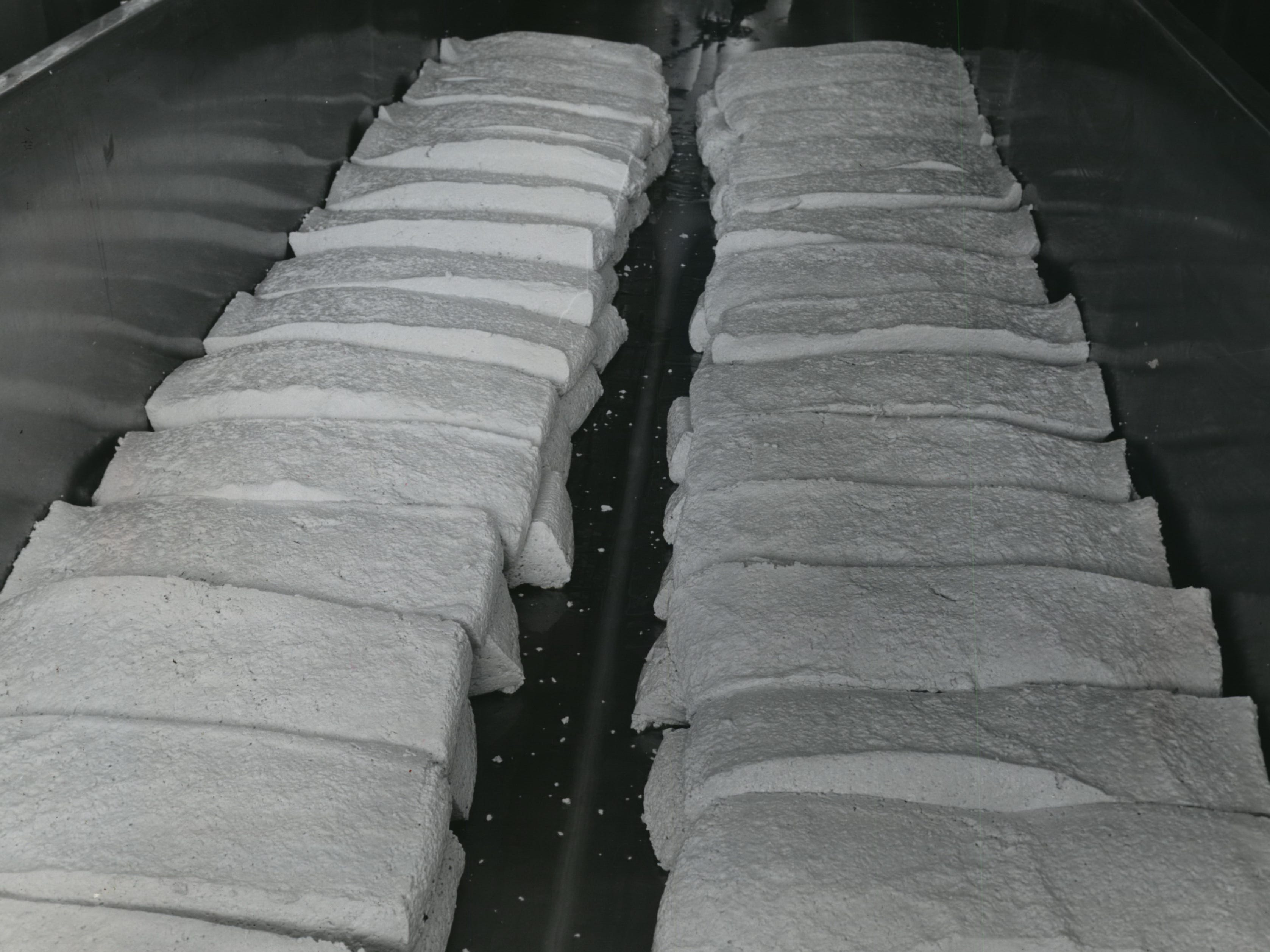 1950s: Cheese manufacturing continued to do well. This image shows what happens to milk when rennet is added. Rennet separates curd (solid) from whey (liquid). The curdled milk can then move to the next step in becoming cheese.