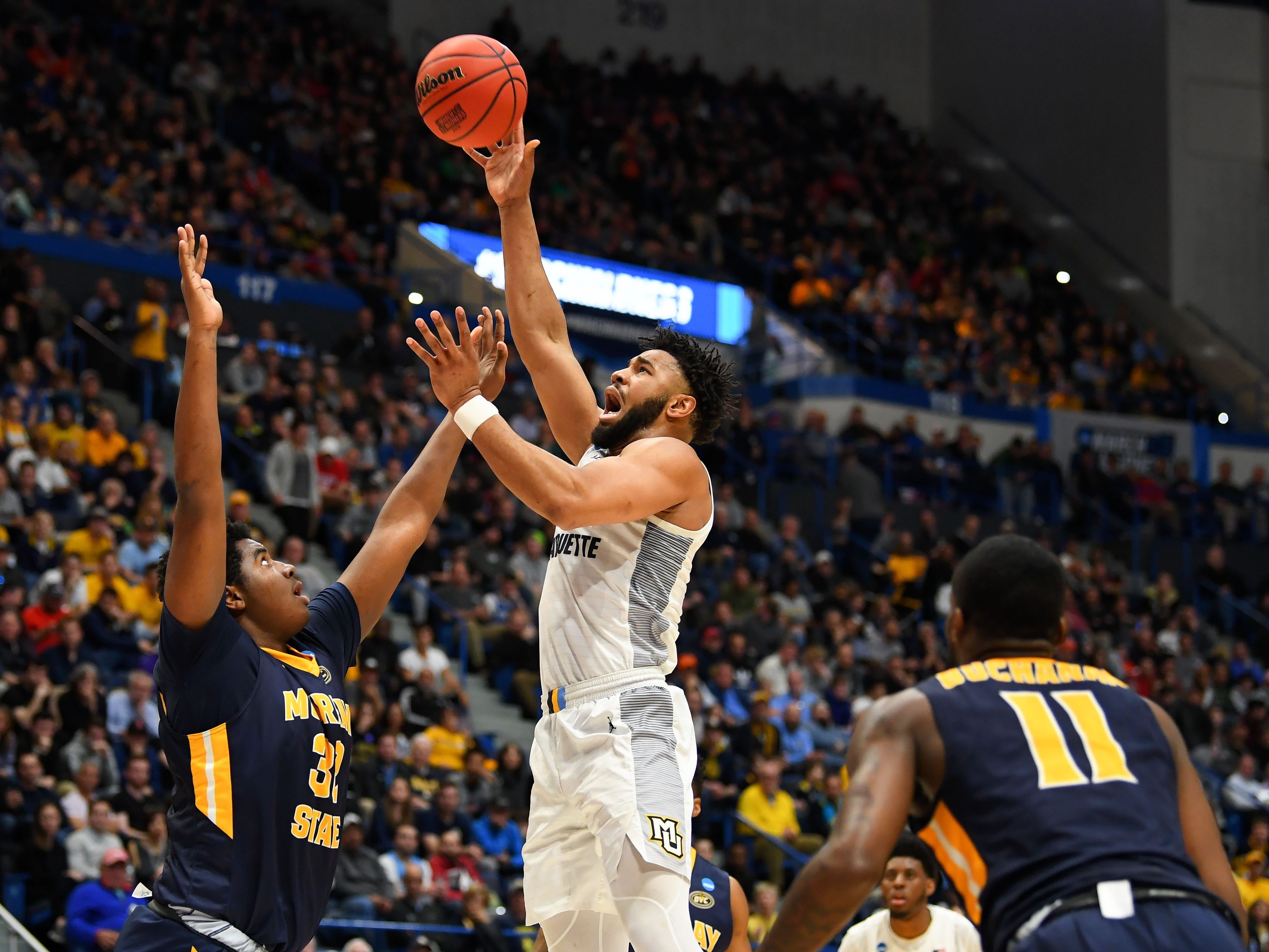 Golden Eagles forward Ed Morrow puts up a shot near the basket over Murray State's Darnell Cowart during the first half.