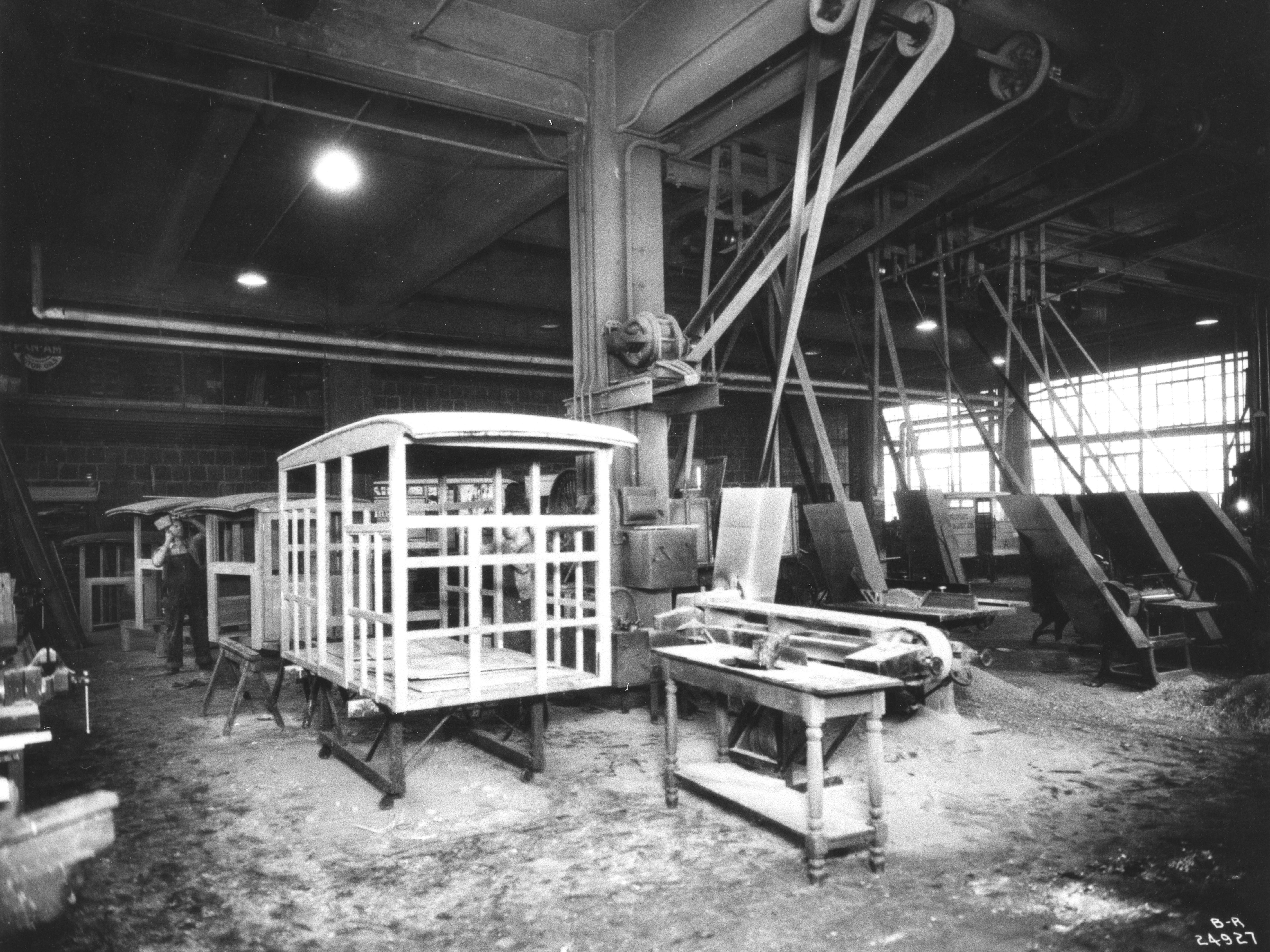 In 1924, milk wagons were still in demand. A worker in the carpentry shop of L.V. Gridley Dairy Co. (1897-1942) assembles wooden frames for future horse-drawn milk wagons. The dairy became part of Borden Co. in 1942.