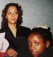 Bianca Hych (left) with her sister Chazidi White in 2001.
