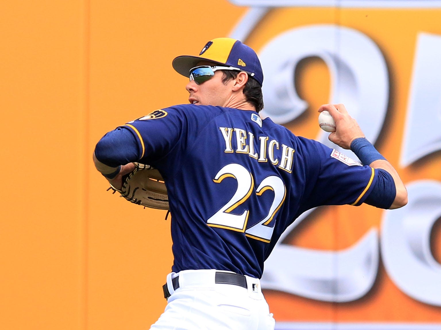 Brewers rightfielder Christain Yelich throws the ball back to the infield after catching a fly ball Thursday.