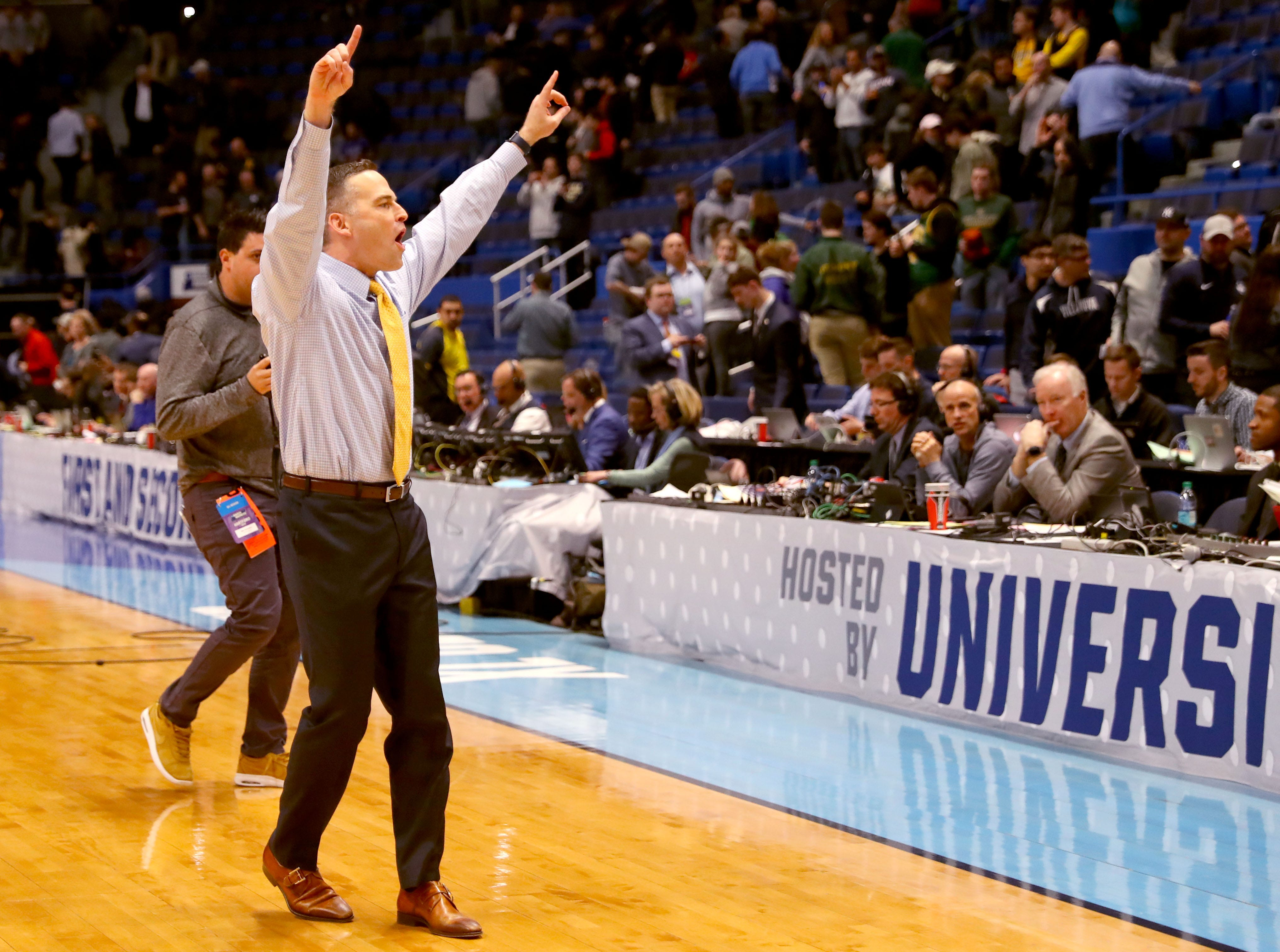 Murray State head coach Matt McMahon gestures toward fans of the Racers after their victory over Marquette.