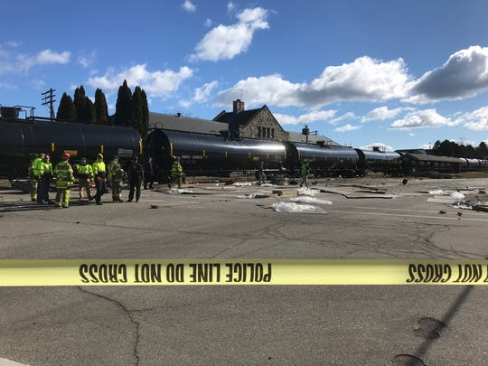 Debris is scattered across the roadway near Maxim's in Oconomowoc after a train hit a semi on the tracks.