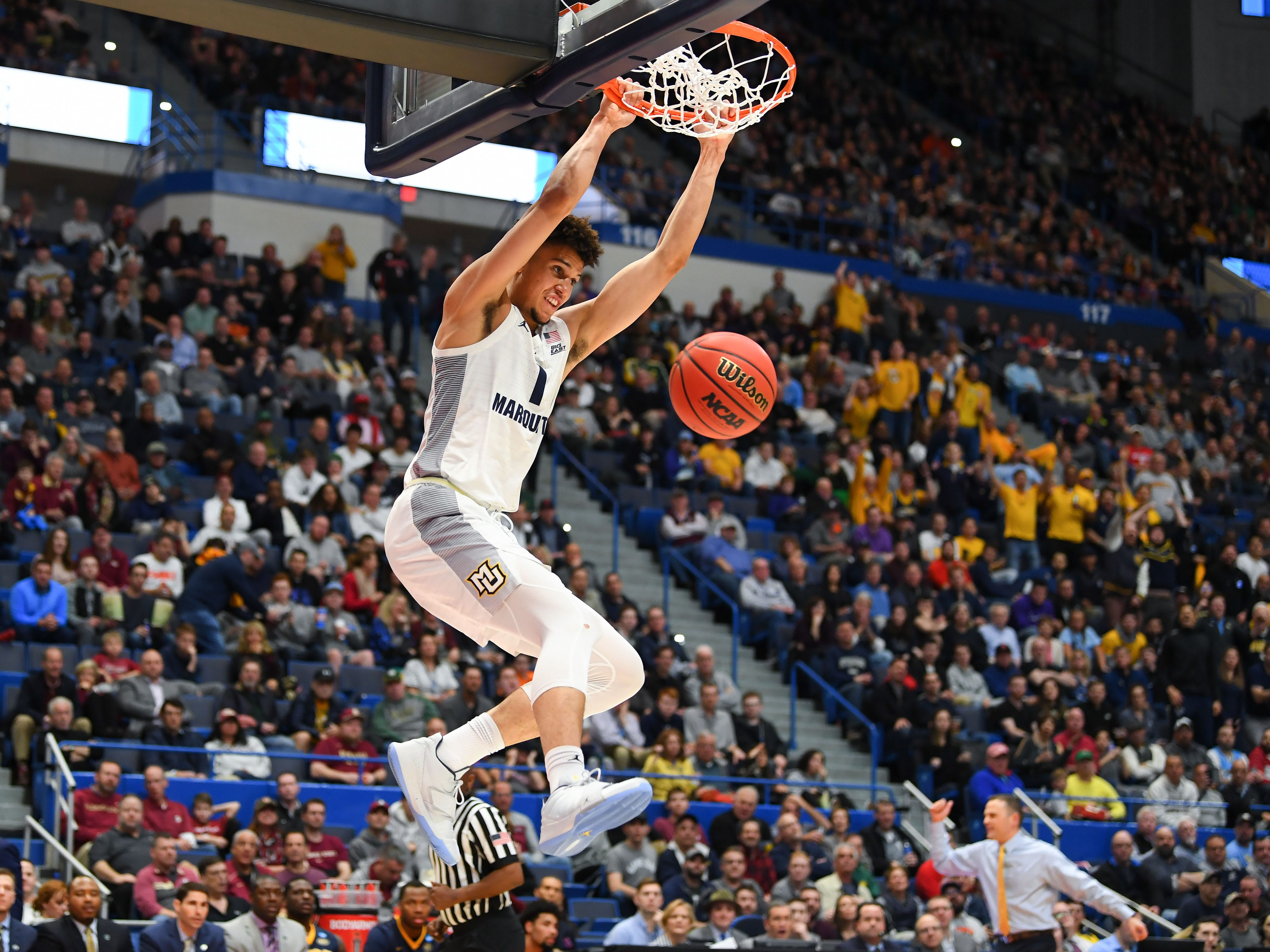 Marquette forward Brendan Bailey throws home a dunks against Murray State during the first half.