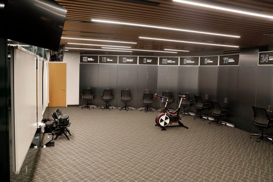 The Milwaukee Bucks locker room has been modified to reflect more of a classroom aspect. Open space with mounted TVs and white boards creates a learning environment as well as a changing area.