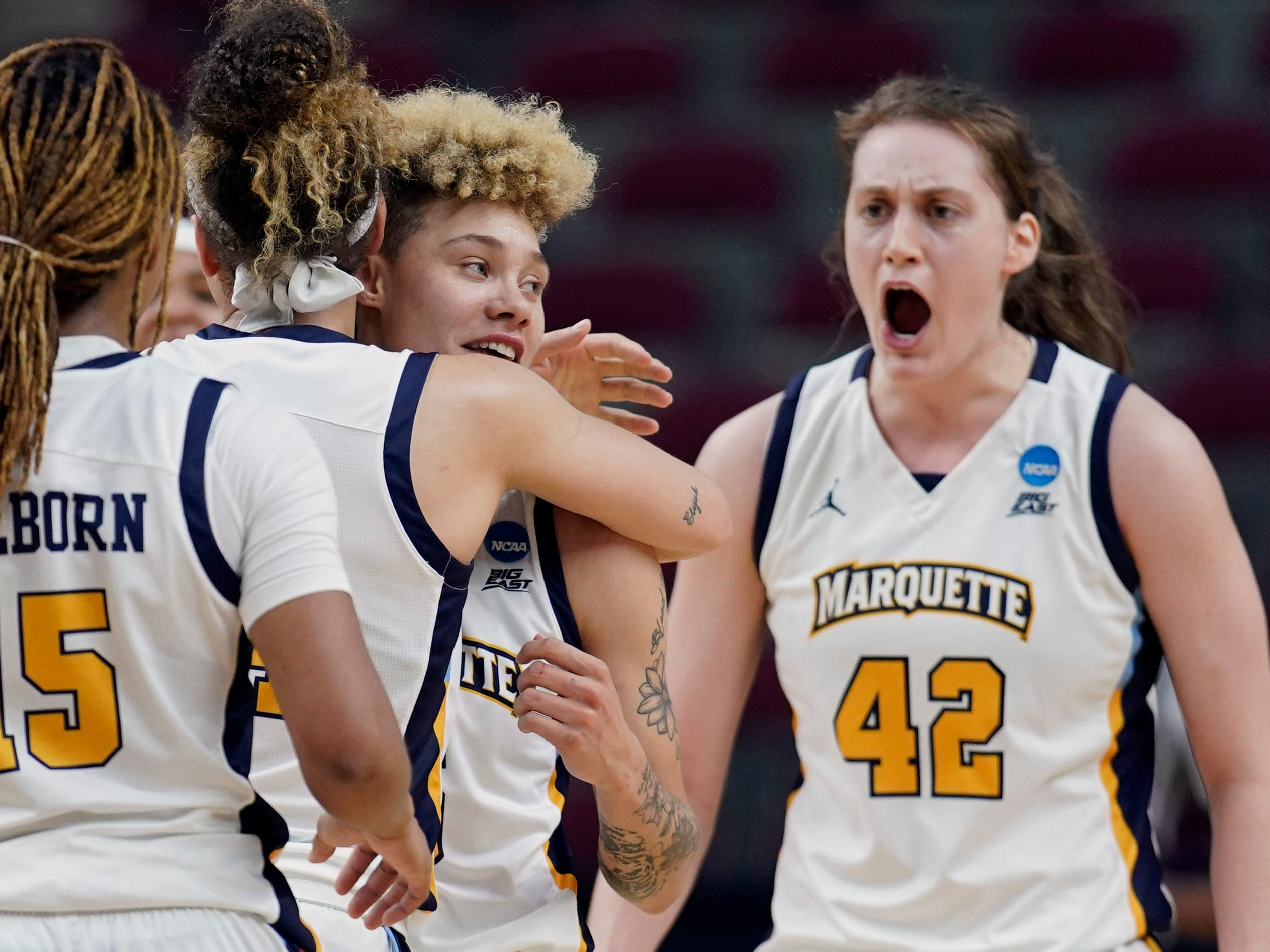 Marquette players celebrate their come-from-behind, overtime victory over Rice in the first round of the NCAA women's basketball tournament Friday.