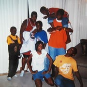 Chazidi White (center) poses with her nephews and kids from the neighborhood in 2003 when she lived with her sister Bianca Hych in Brown Deer.