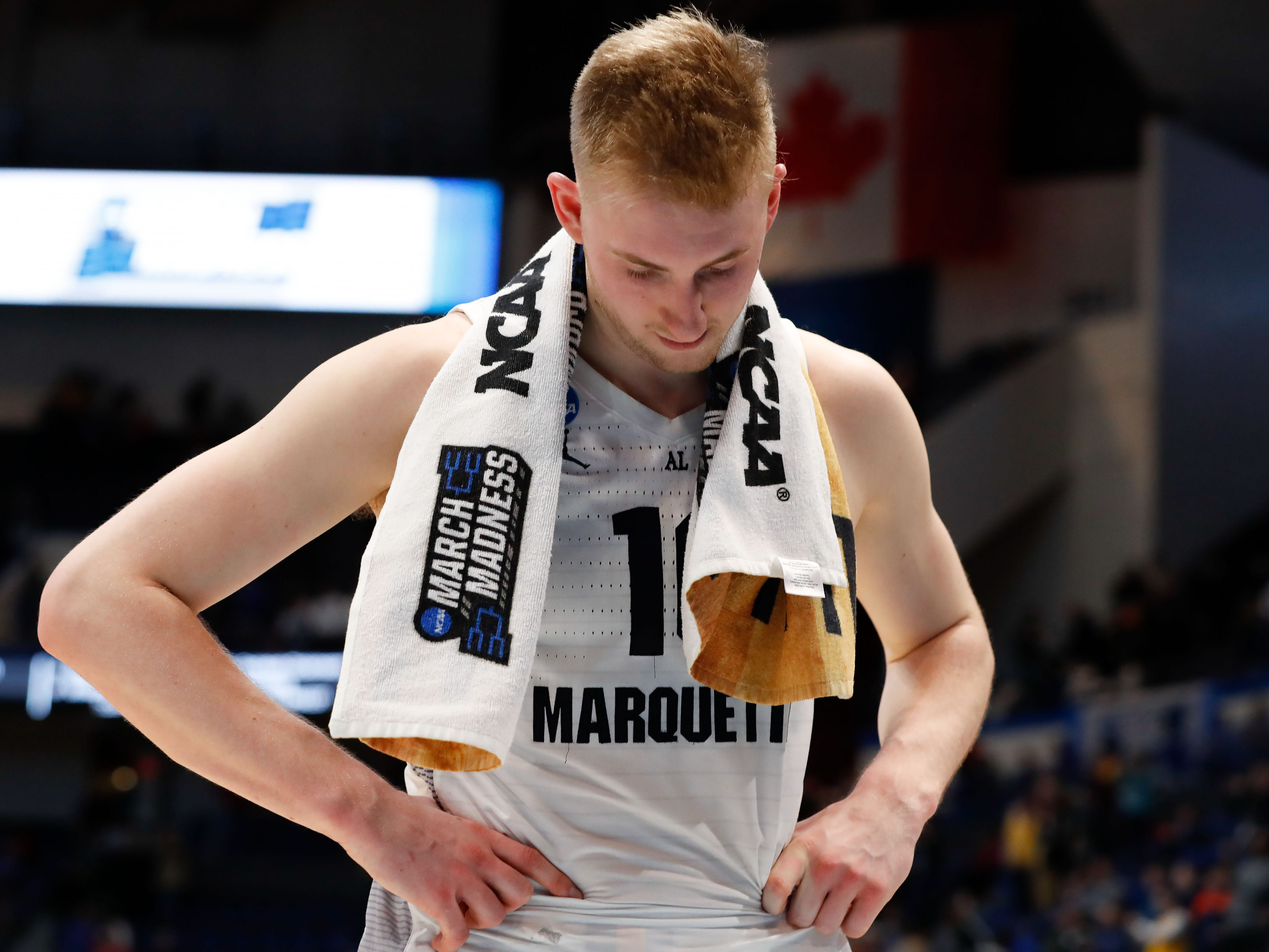 A dejected Sam Hauser walks off of the court after Marquette's loss to the Murray State.