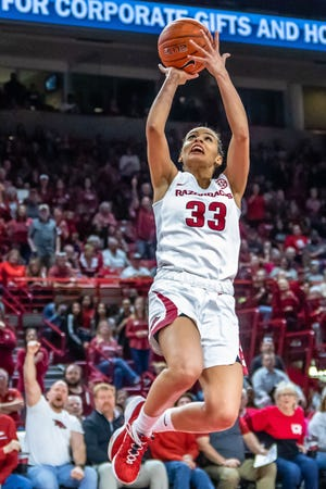 Arkansas senior Chelsea Dungee goes to the hoop for two of her 37 points in the team's overtime win Thursday at Walton Arena. Dungeenow has 724 points on the year to surpassthe Arkansas season-high 692 points scored by Shelley Wallace in 1989.