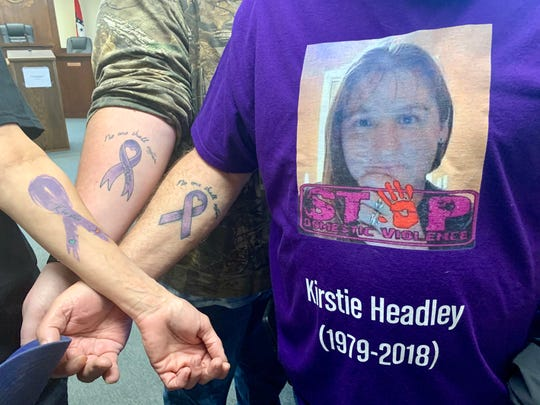 Family members of Kirstie Dawn Headley are shown displaying tattoos they received to honor the victim of domestic violence.