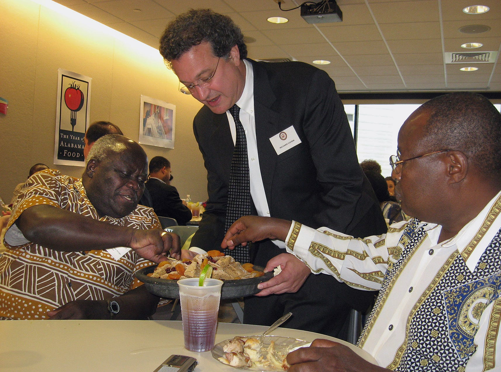 Richard Cohen of the Southern Poverty Law Center serves dessert to K.F.X. ole Kaparo, (cq) right, speaker of the Kenyan National Assembly and assembly colleague Peter Oloo Aringo, (cq), Saturday, Sept. 2, 2006, at the SPLC Civil Rights Museum. (Montgomery Advertiser, Alvin Benn)