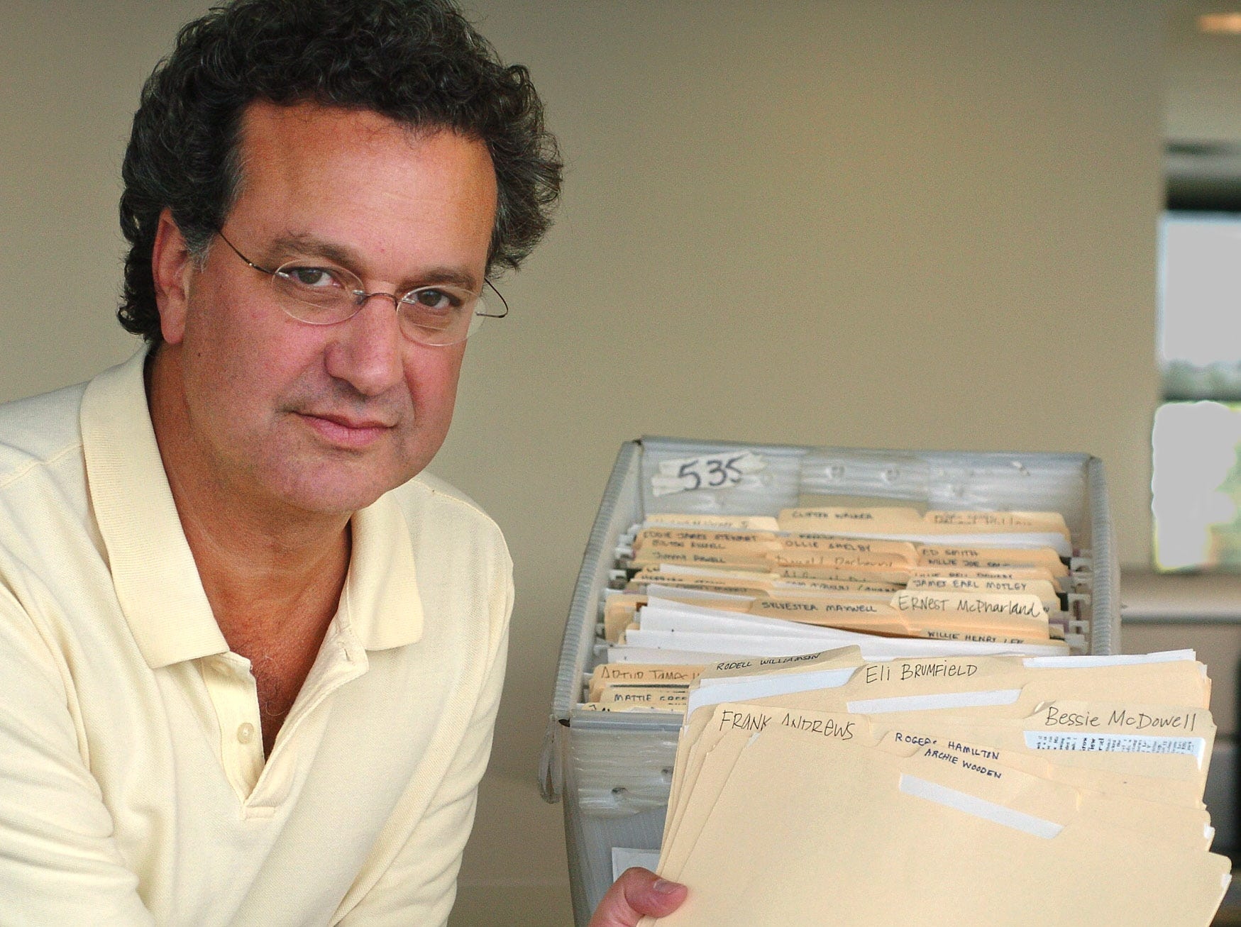 Aug. 21 -- Richard Cohen, president of the Southern Poverty Law Center, holds with some of their unsolved Alabama murder files as seen on Tuesday, Aug. 21, 2007, at their office  in Montgomery, Ala. In the background are unsolved murder files from other states.(Montgomery Advertiser, Lloyd Gallman)