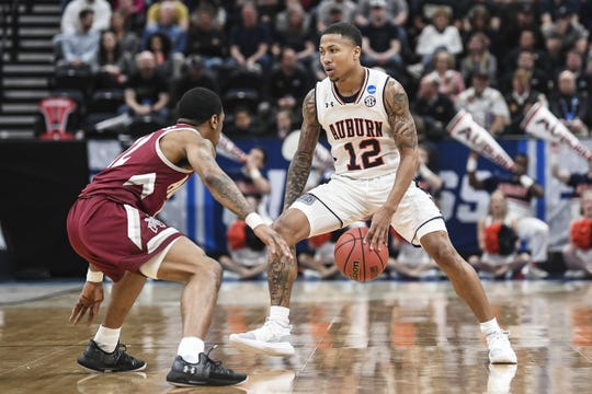 Auburn guard J'Von McCormick brings the ball up the court against New Mexico State in the first round of the NCAA Tournament on March 21, 2019, in Salt Lake City.