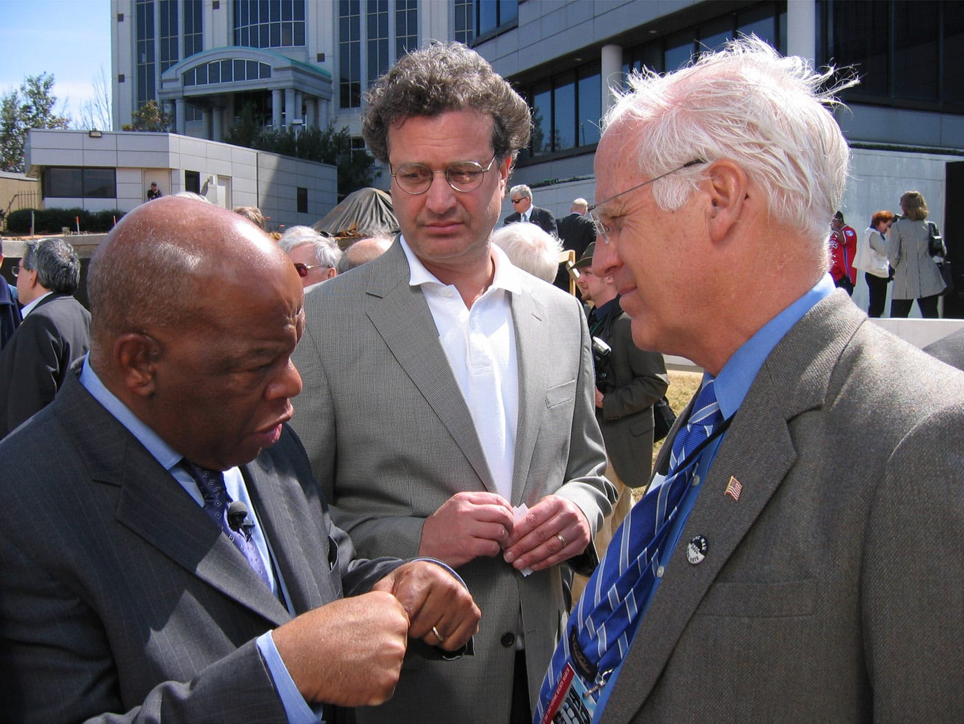 U.S. Rep. John Lewis, D-Atlanta, left, chats with U.S. Rep. Christopher Shays, R-Conn., right and Richard Cohen, Saturday afternoon during a ceremony at the Southern Poverty Law Center's Civil Rights Memorial, Saturday, March 3, 2005.