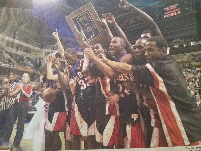 Terrance Sevion (No. 24) and his teammates celebrate after winning the Class 3A state championship in 2000.