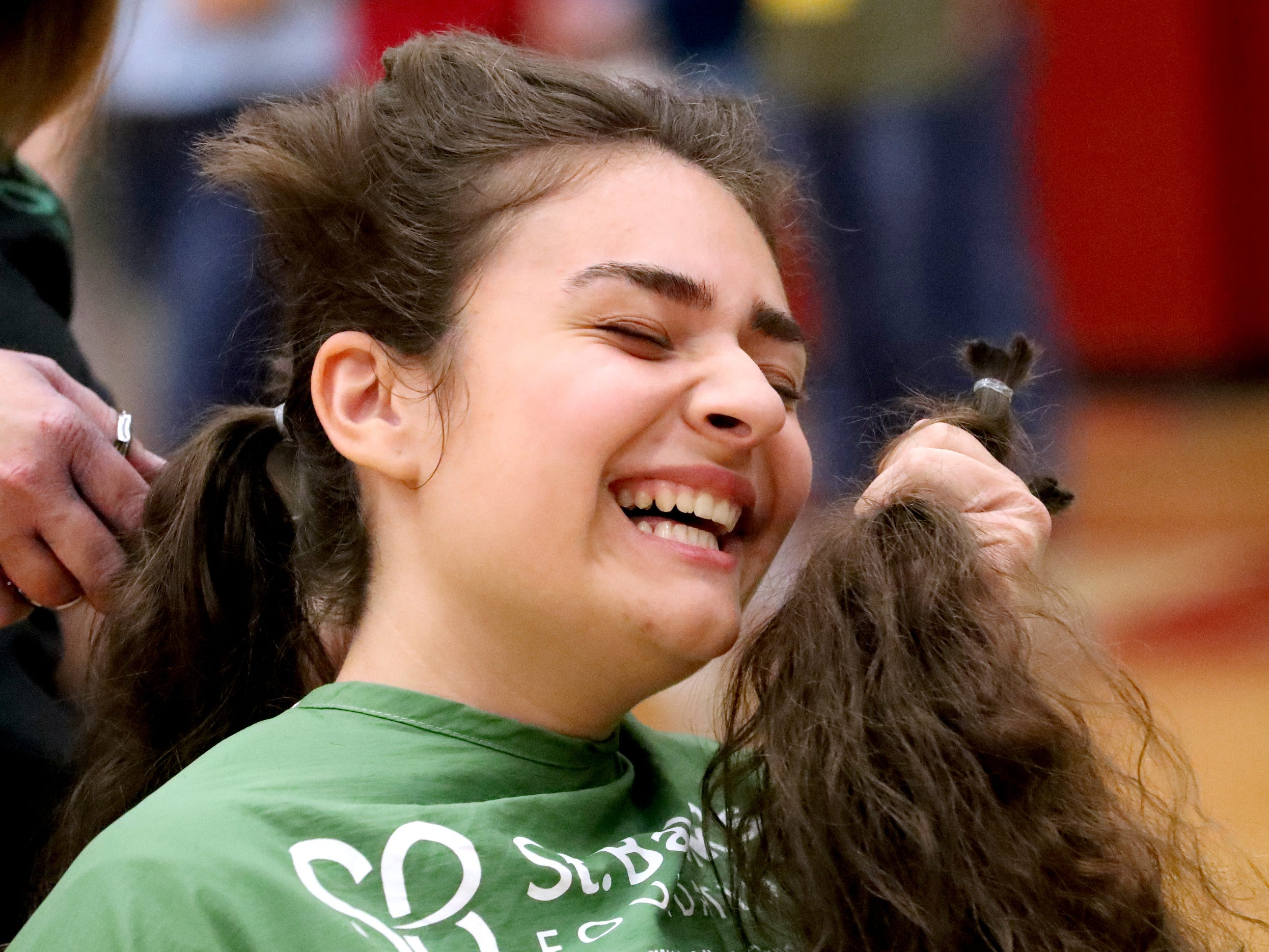 Rverdale junior Steph Nikel reacts as she gets her hair cut before it shaved during Riverdale High School's sixth annual Brave the Shave fundraiser to benefit St. Baldrick's Foundation on Thursday, March 21, 2019. The organization raises funds and awareness for childhood cancer.