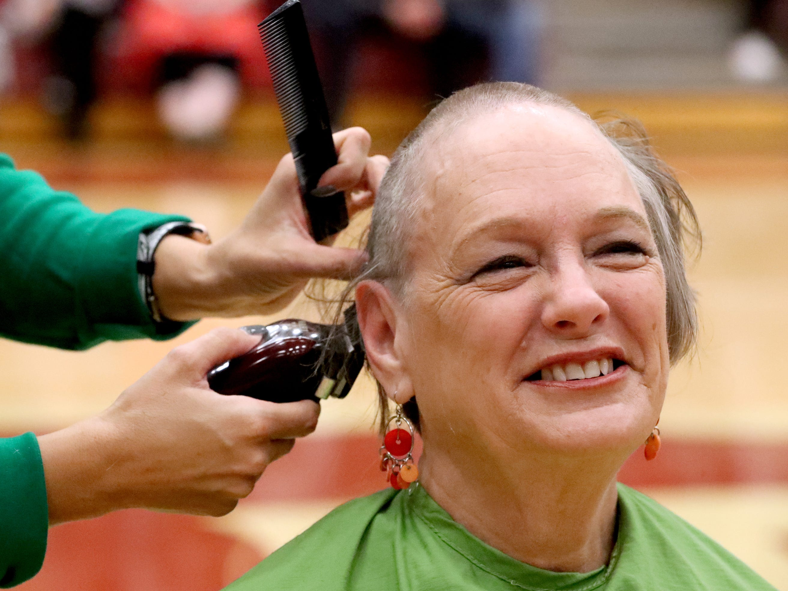 Kathy Youse reacts as she gets her head shaved during Riverdale High School's sixth annual Brave the Shave fundraiser to benefit St. Baldrick's Foundation on Thursday, March 21, 2019. The organization raises funds and awareness for childhood cancer.