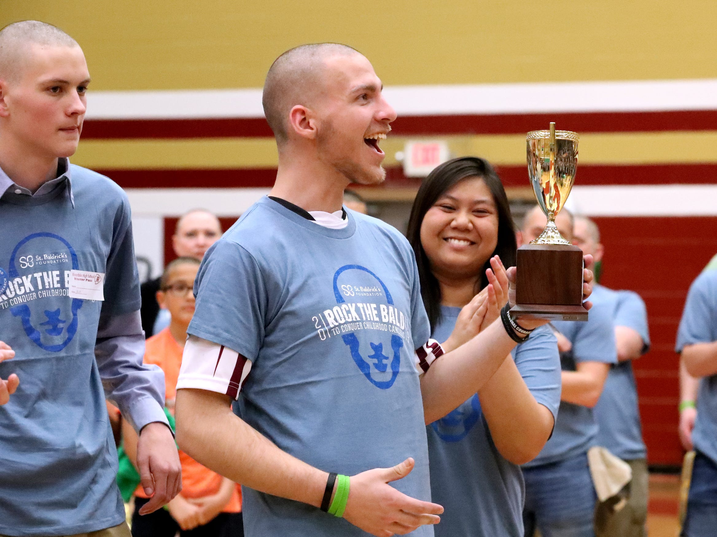 Caleb Shew and his team raised the most money during the Riverdale High School's sixth annual Brave the Shave fundraiser to benefit St. Baldrick's Foundation on Thursday, March 21, 2019. The organization raises funds and awareness for childhood cancer.