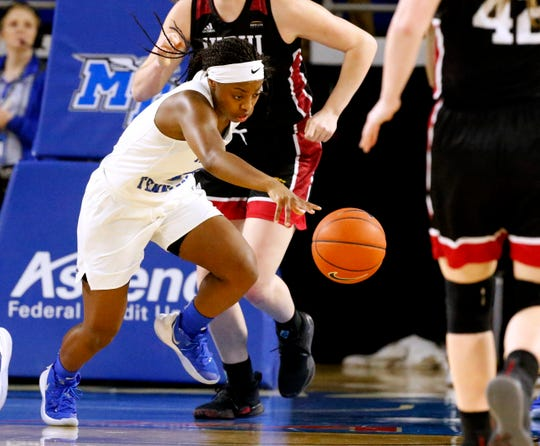 MTSU guard Taylor Sutton (2) grabs the ball and takes it up the court during the first round of the WNIT, on Thursday, March 21, 2019, at Murphy Center in Murfreesboro, Tenn..