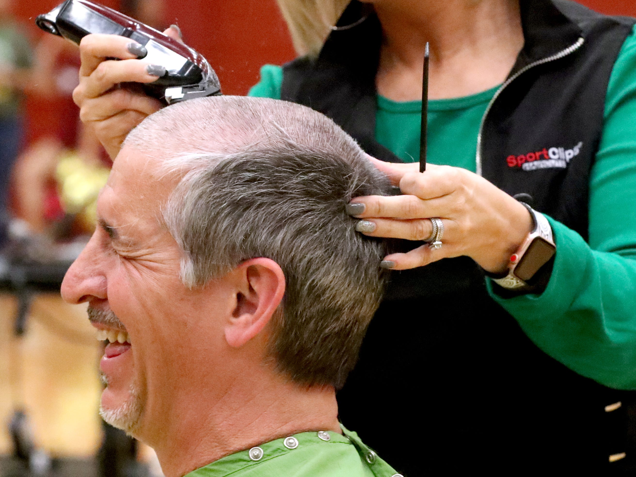 Lamar Davis reacts as she gets her head shaved during Riverdale High School's sixth annual Brave the Shave fundraiser to benefit St. Baldrick's Foundation on Thursday, March 21, 2019. The organization raises funds and awareness for childhood cancer.
