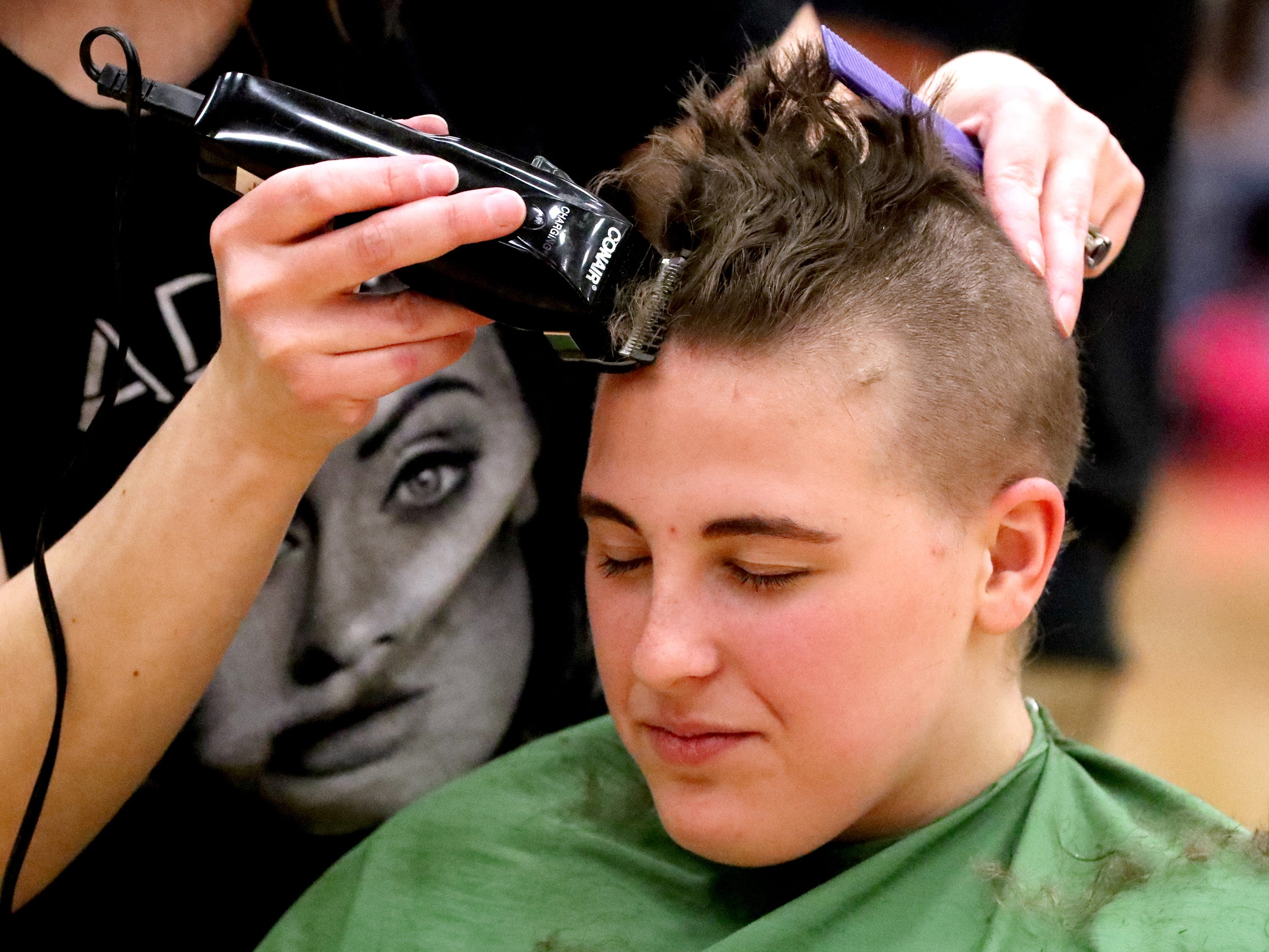 Riverdale senior Brillian Orr gets her head shaved during Riverdale High School's sixth annual Brave the Shave fundraiser to benefit St. Baldrick's Foundation on Thursday, March 21, 2019. The organization raises funds and awareness for childhood cancer.