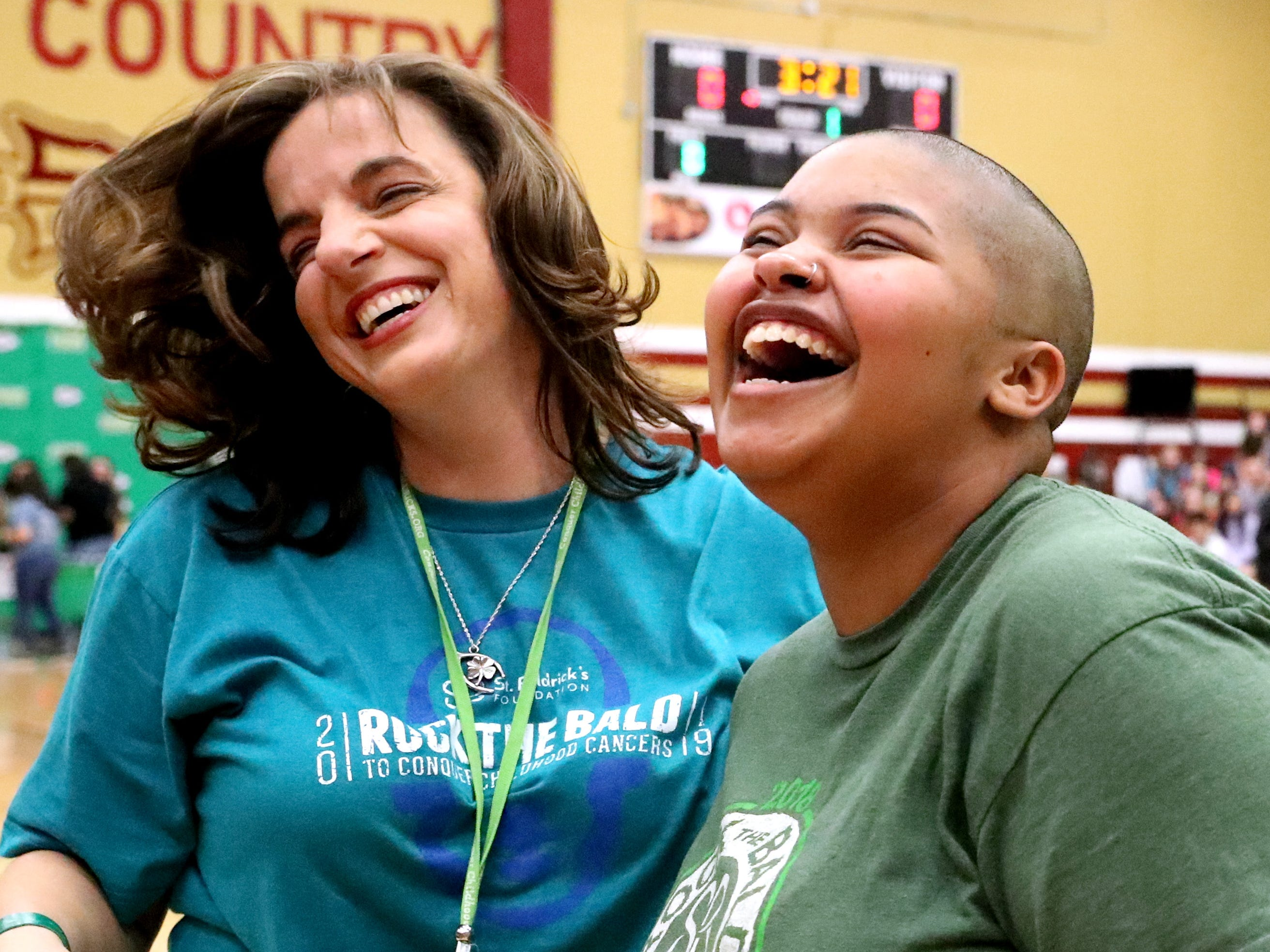 Riverdale teacher Caron Peck and Riverdale junior Arial Witty Floyd react after Witty Floyd gets her head shaved during Riverdale High School's sixth annual Brave the Shave fundraiser to benefit St. Baldrick's Foundation on Thursday, March 21, 2019. The organization raises funds and awareness for childhood cancer.