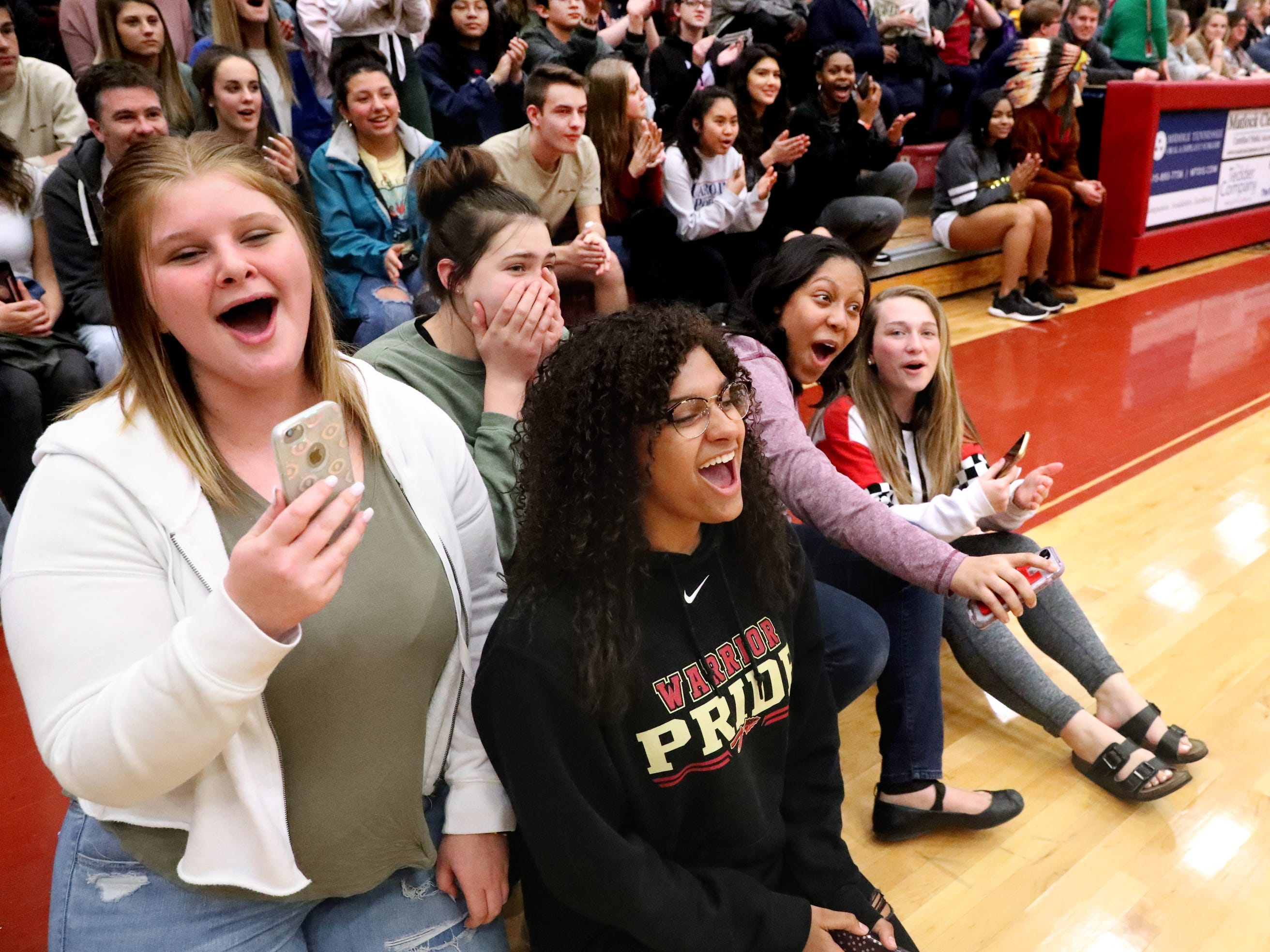 The crowd reacts as people get their hair shaved and cut during Riverdale High School's sixth annual Brave the Shave fundraiser to benefit St. Baldrick's Foundation on Thursday, March 21, 2019. The organization raises funds and awareness for childhood cancer.