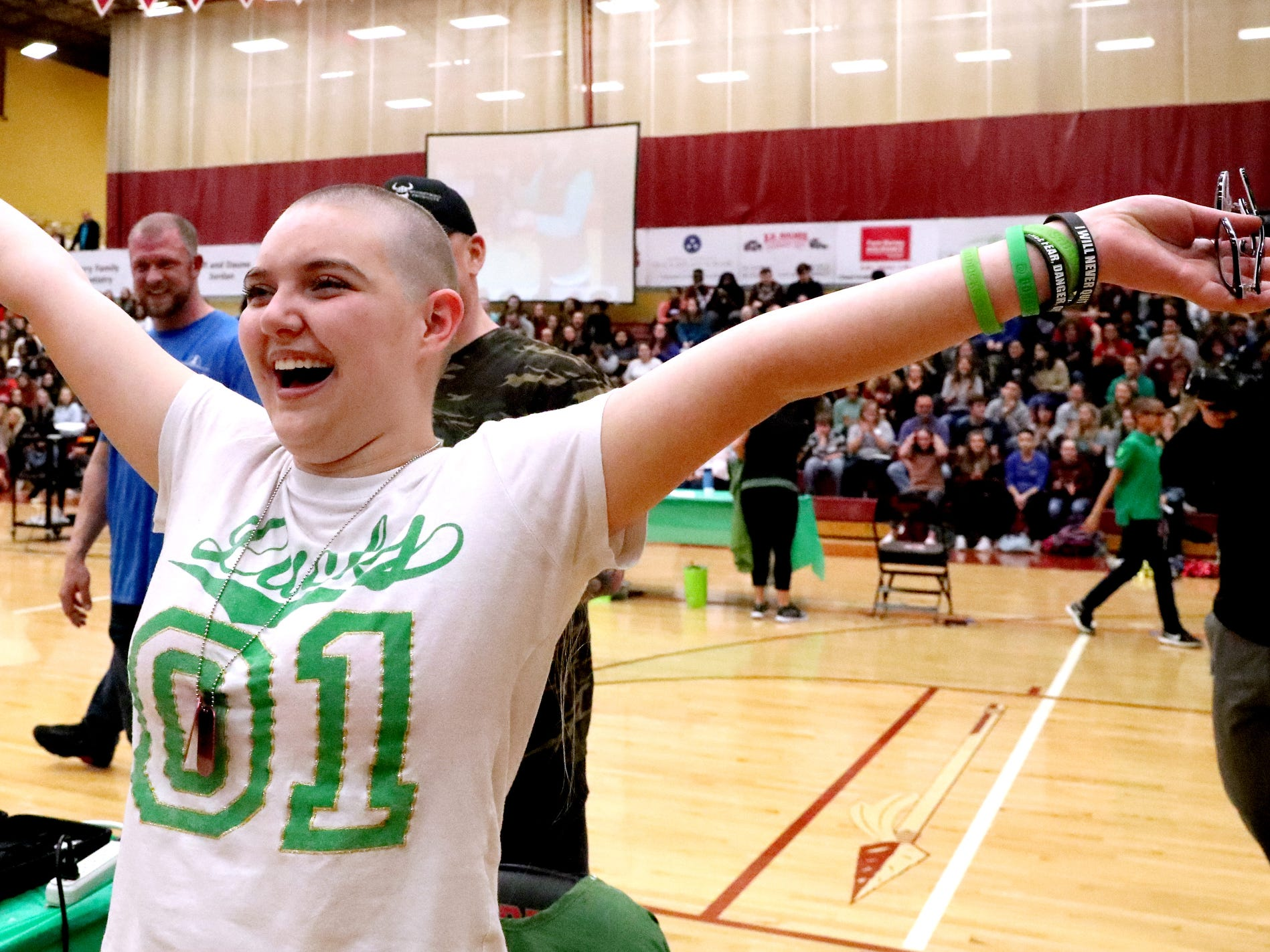 Kalianna Buck celebrates after she gets her head shaved during Riverdale High School's sixth annual Brave the Shave fundraiser to benefit St. Baldrick's Foundation on Thursday, March 21, 2019. The organization raises funds and awareness for childhood cancer.