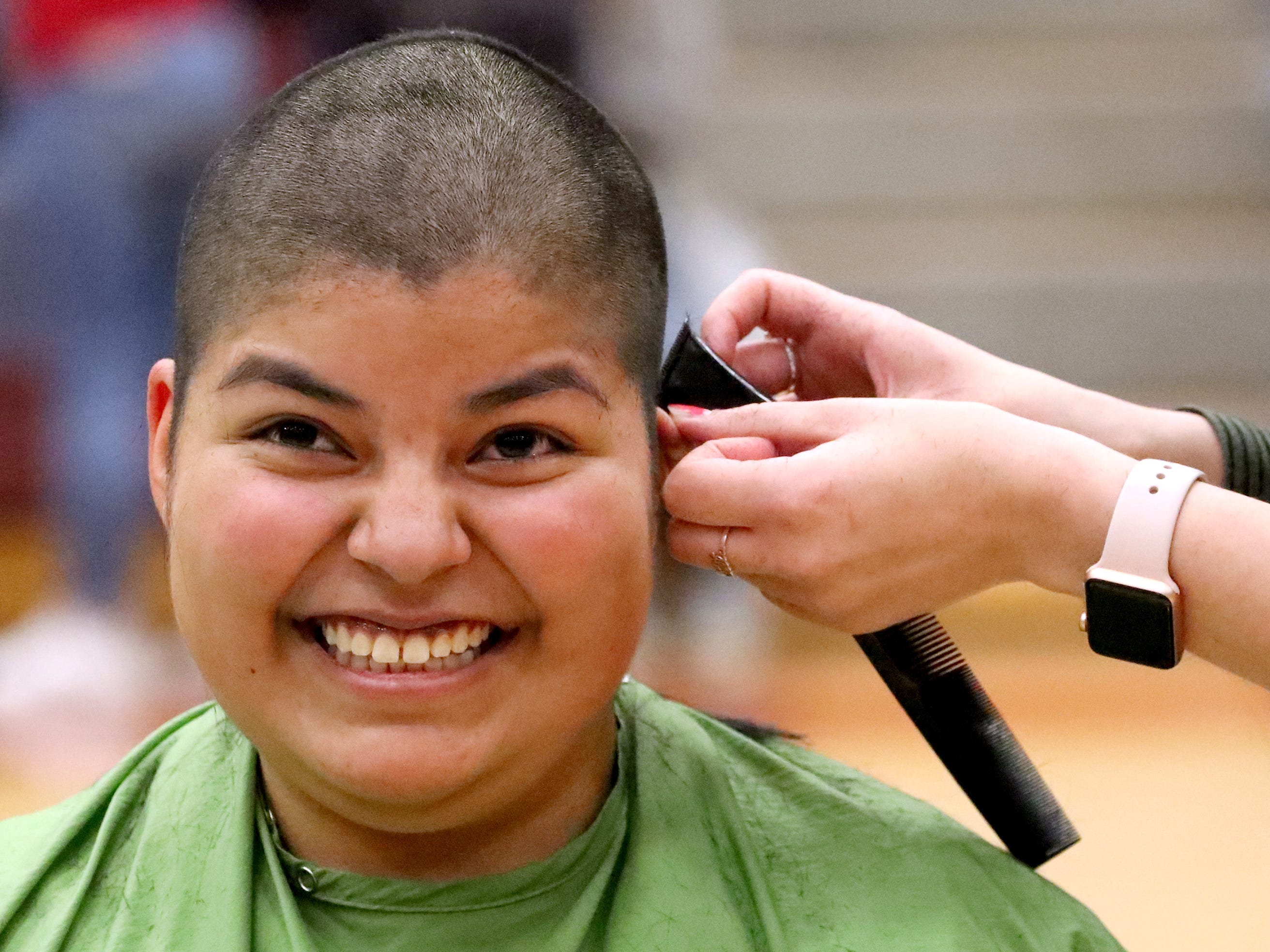 Riverdale senior Juliana Cordova reacts as she gets her head shaved during Riverdale High School's sixth annual Brave the Shave fundraiser to benefit St. Baldrick's Foundation on Thursday, March 21, 2019. The organization raises funds and awareness for childhood cancer.