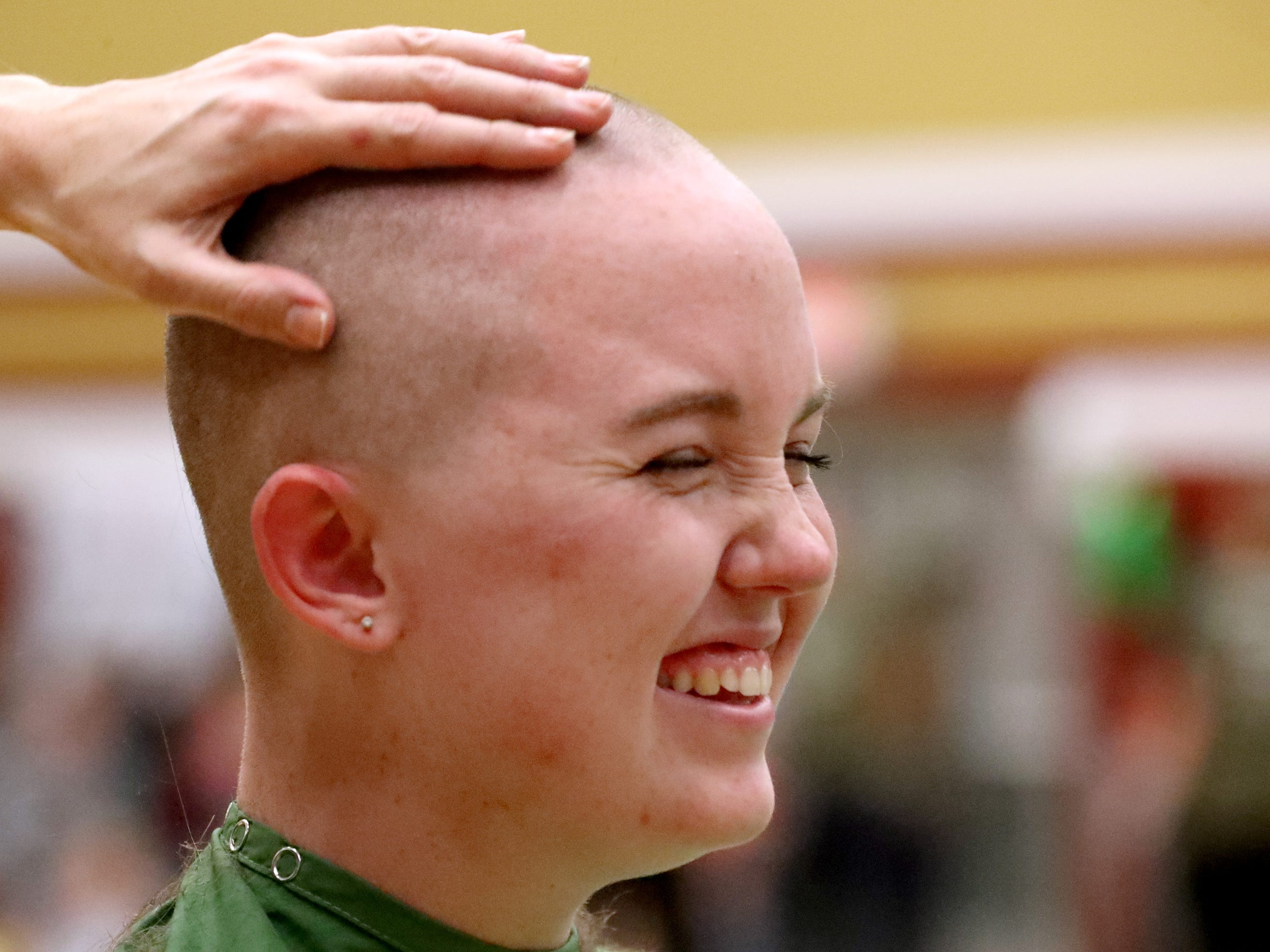 Riverdale senior Ainsley Fisher reacts as she gets her head shaved during Riverdale High School's sixth annual Brave the Shave fundraiser to benefit St. Baldrick's Foundation on Thursday, March 21, 2019. The organization raises funds and awareness for childhood cancer.