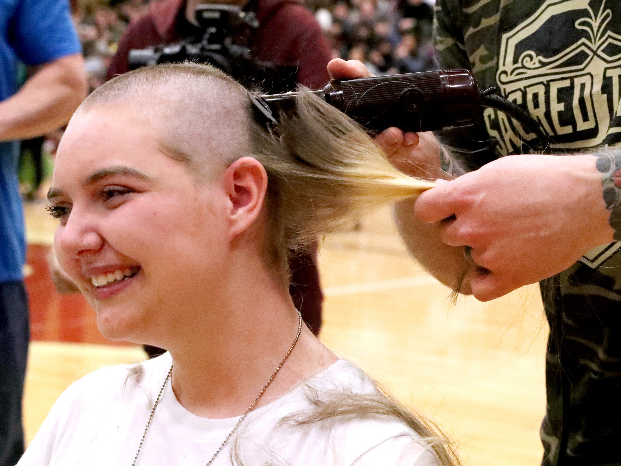Kalianna Buck gets her head shaved during Riverdale High School's sixth annual Brave the Shave fundraiser to benefit St. Baldrick's Foundation on Thursday, March 21, 2019. The organization raises funds and awareness for childhood cancer.