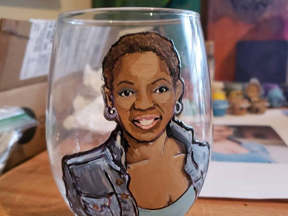 Painted wine glass created by April Nealey, artist at the Rutherford County Hot Chicken and Art Show.