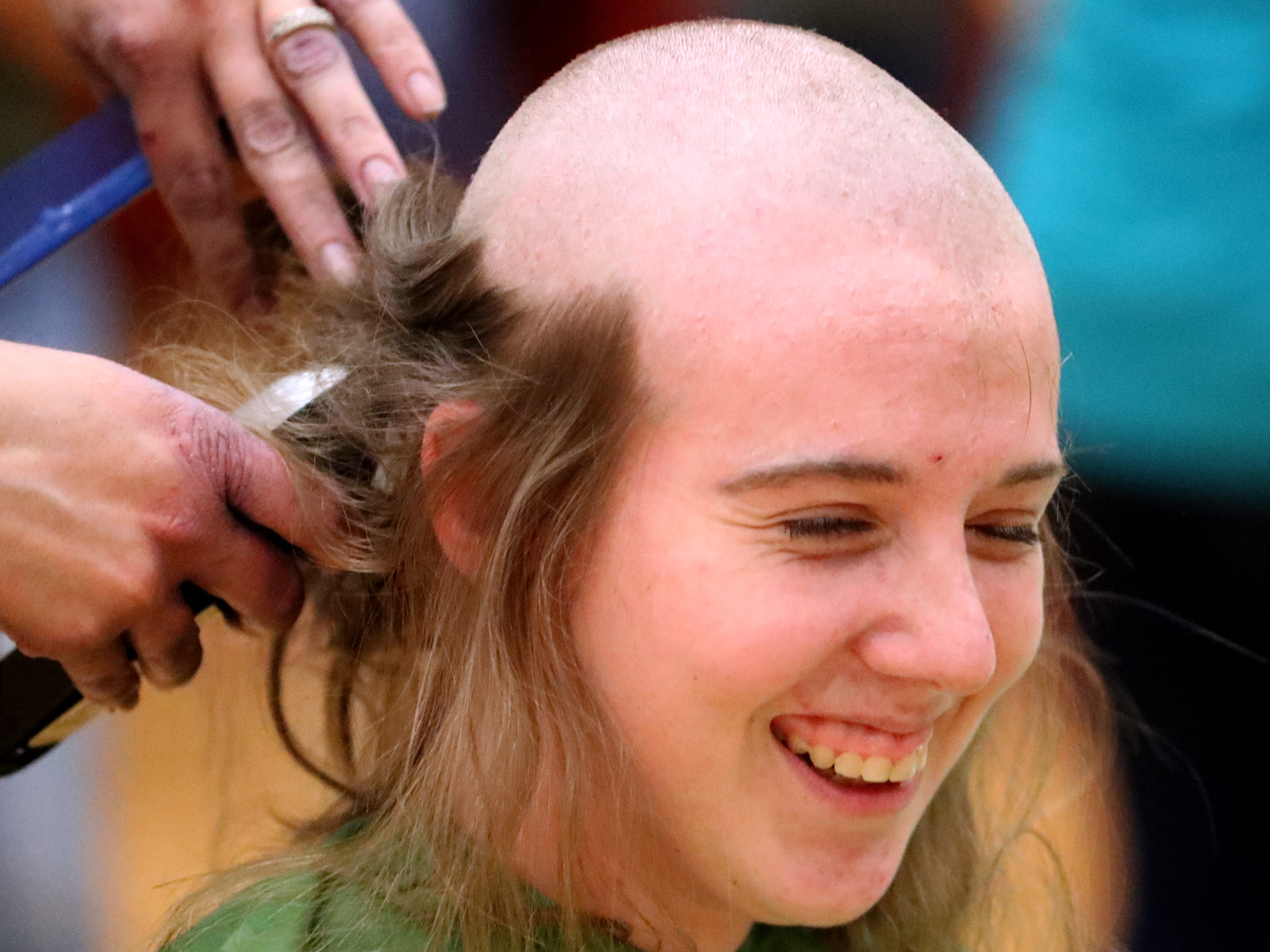 Riverdale junior Trinity Patrick reacts as she gets her head shaved during Riverdale High School's sixth annual Brave the Shave fundraiser to benefit St. Baldrick's Foundation on Thursday, March 21, 2019. The organization raises funds and awareness for childhood cancer.