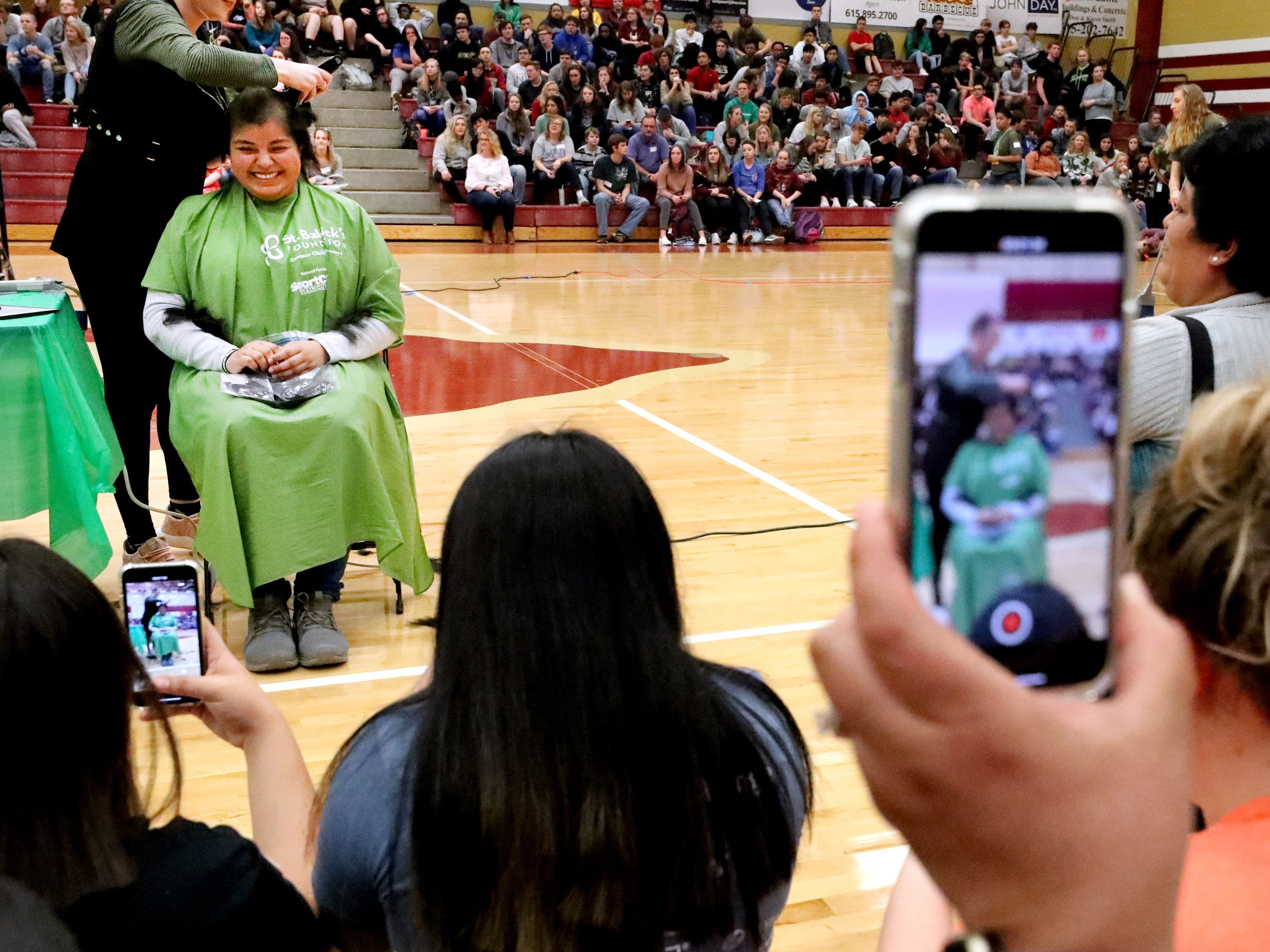 Riverdale senior Juliana Cordova gets her head shaved during Riverdale High School's sixth annual Brave the Shave fundraiser to benefit St. Baldrick's Foundation on Thursday, March 21, 2019. The organization raises funds and awareness for childhood cancer.