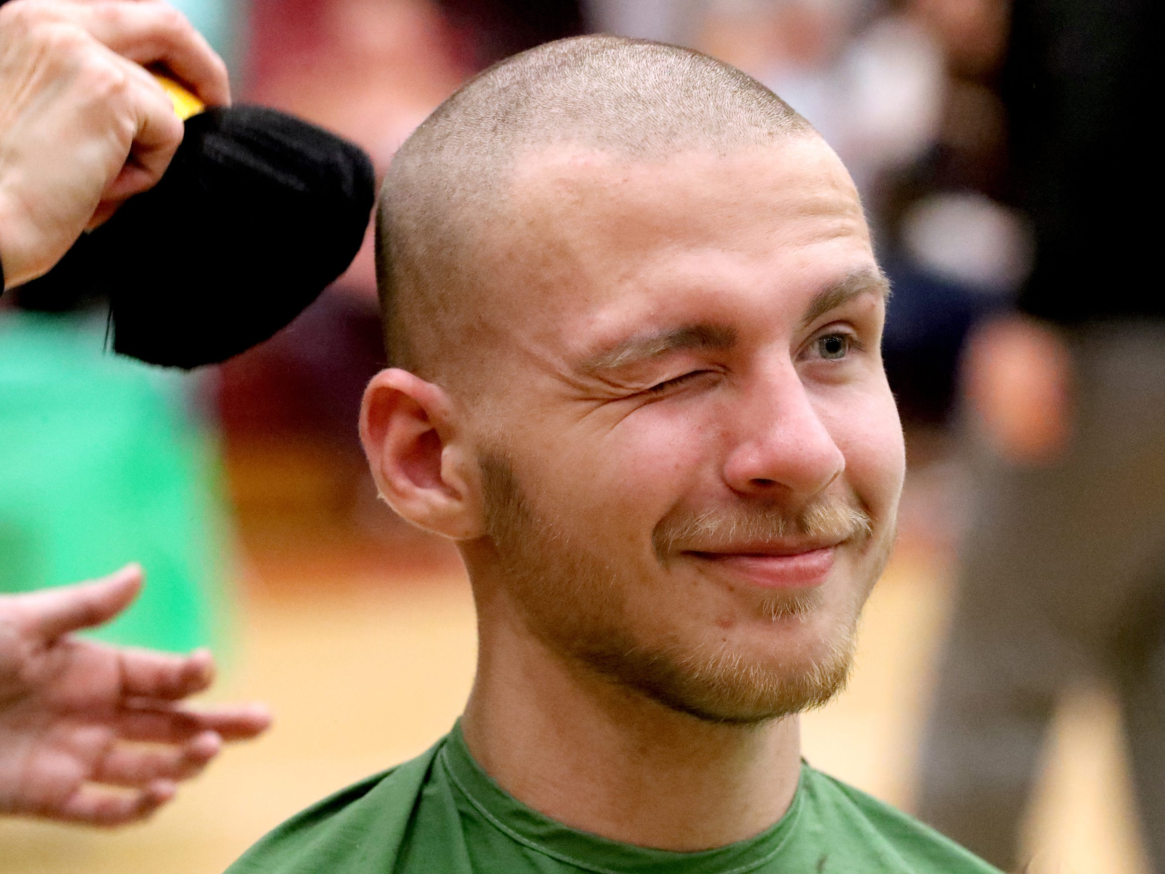 Riverdale student Caleb Shew reacts as his head is brushed off after he got his head shaved during Riverdale High School's sixth annual Brave the Shave fundraiser to benefit St. Baldrick's Foundation on Thursday, March 21, 2019. The organization raises funds and awareness for childhood cancer.