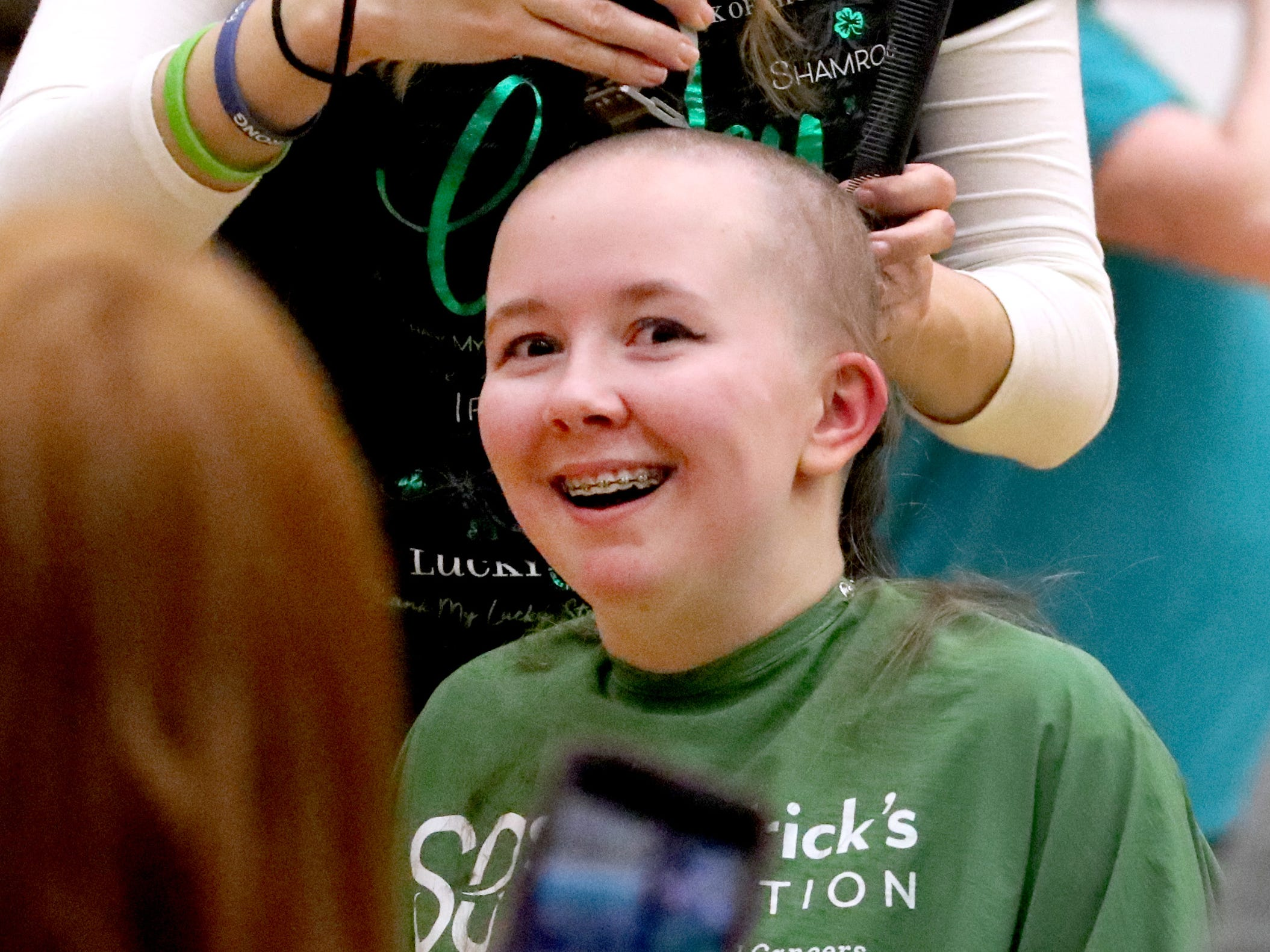 Riverdalesenior Annika Clarey reacts as she gets her head shaved during Riverdale High School's sixth annual Brave the Shave fundraiser to benefit St. Baldrick's Foundation on Thursday, March 21, 2019. The organization raises funds and awareness for childhood cancer.
