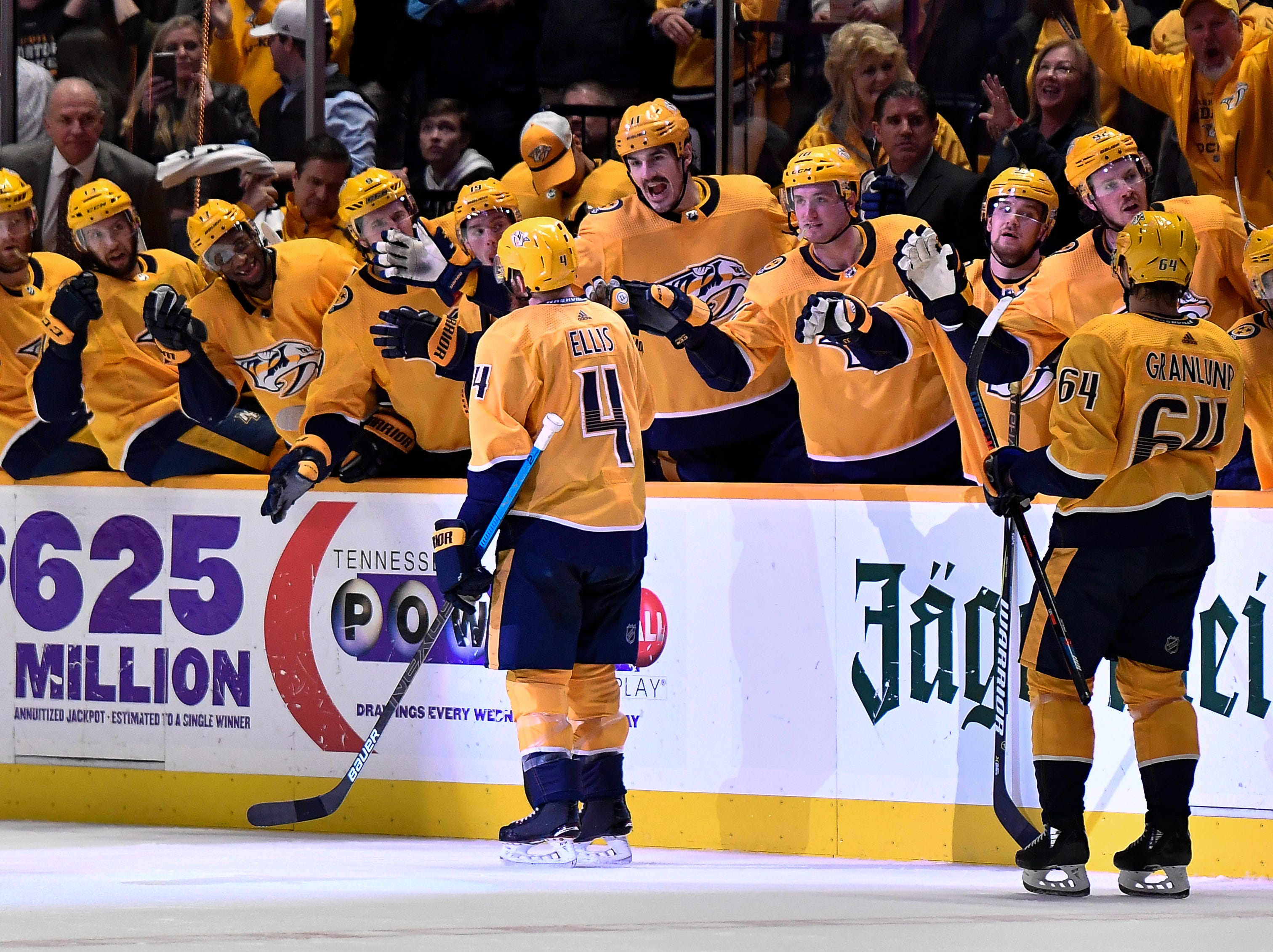 Predators defenseman Ryan Ellis (4) is congratulated after his goal against the Penguins during the third period to tie the game at Bridgestone Arena Thursday, March 21, 2019 in Nashville, Tenn.