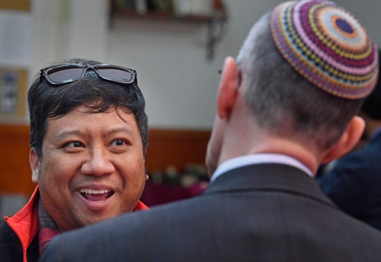 Arylo Hasnugung talks with Eric Stillman as Nashville-area Jewish leaders visited the Islamic Center of Nashville on Friday for midday prayers to show their solidarity in the wake of the New Zealand attacks.